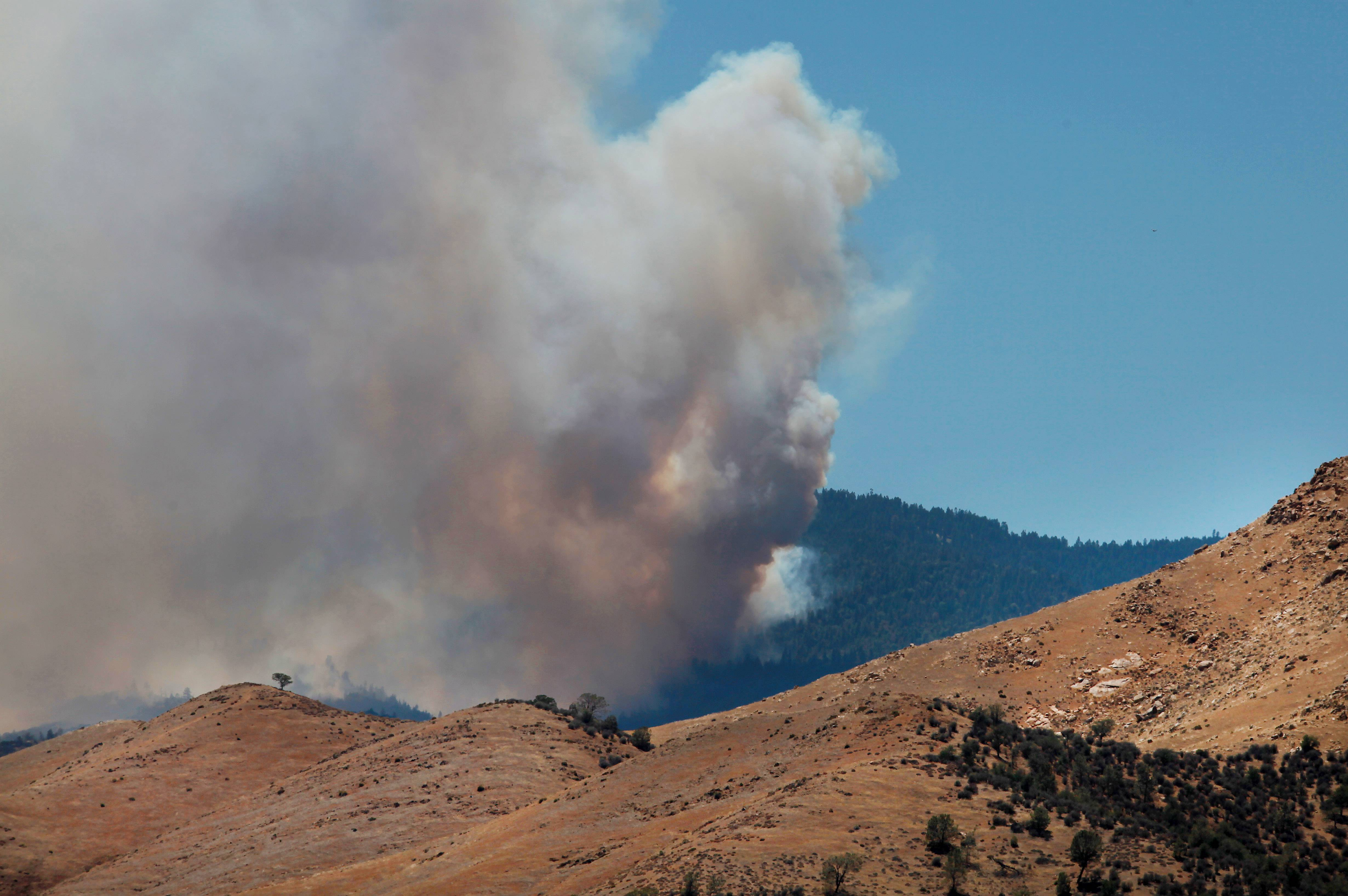 Heavy smoke from the Shirley Fire above Wofford Heights, Calif., is seen Sunday. The Forest Service reported Sunday morning that the amount of acreage charred by the fire burning about 30 miles northeast of Bakersfield more than doubled overnight to 2.8 square miles.