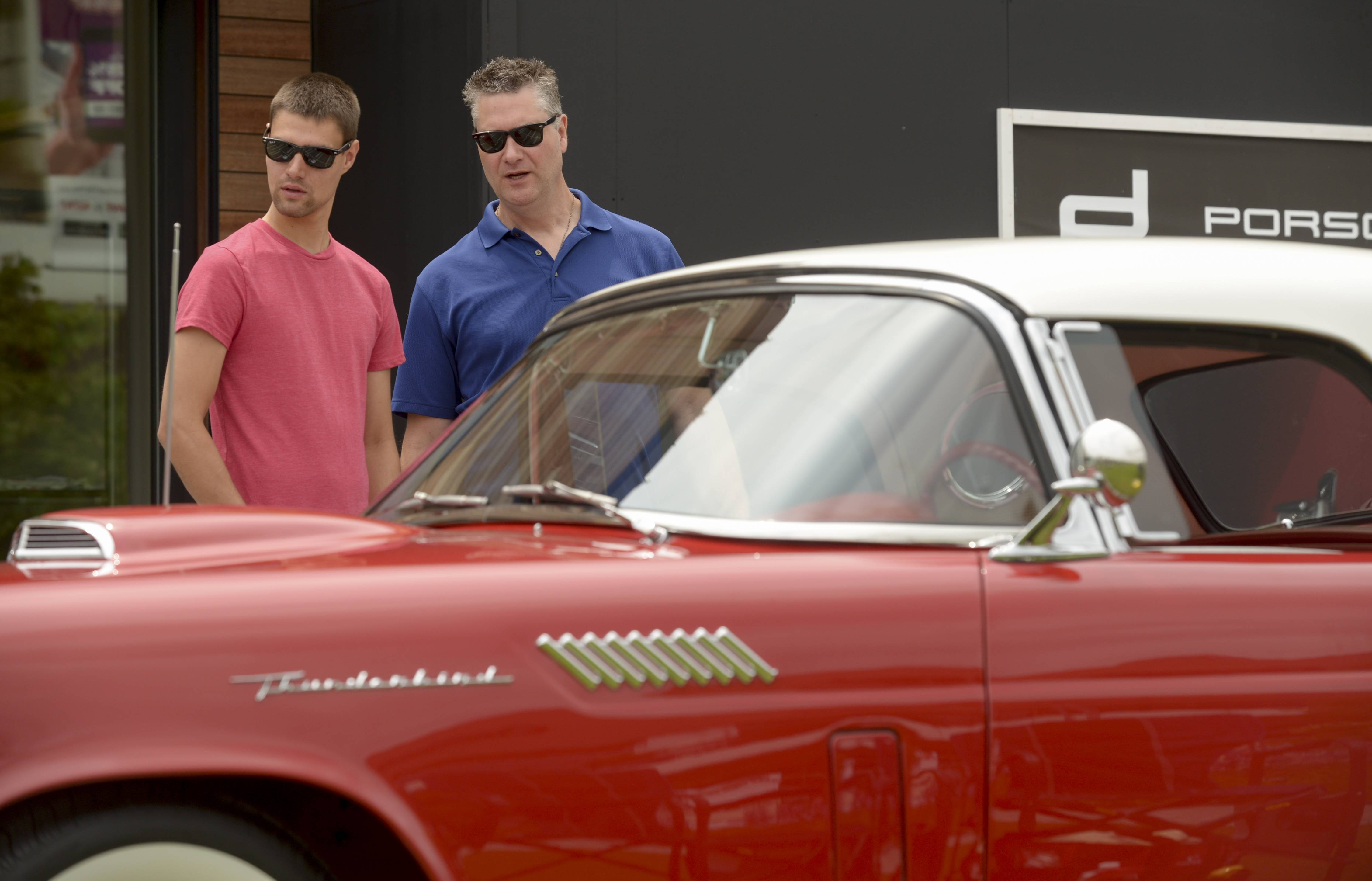 Erik Wright and his father, Bill, of Lombard attend the 46th annual Father's Day Classic Car Show Sunday at Oakbrook Center. The two have been coming to the show for more than 19 years.