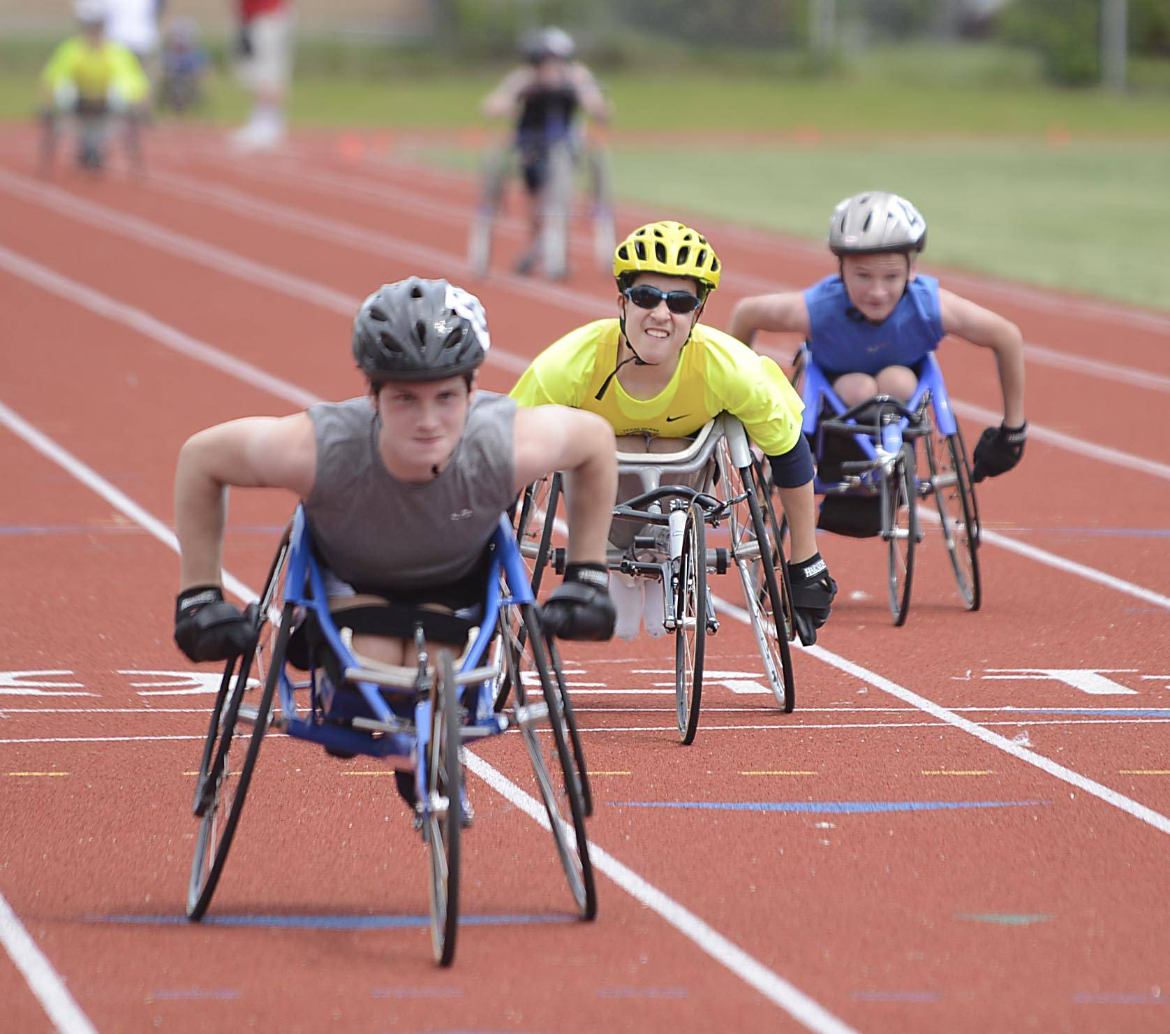 Ethan Burkhardt, 13, of Libertyville, crosses the finish line in the 100 meter dash at the Great Lake Adaptive Sports Association 2014 Adult Regional Games at Lake Forest High School Sunday. Burkhardt was born with spina bifida and has qualified for three events in the national championships in Iowa in July.