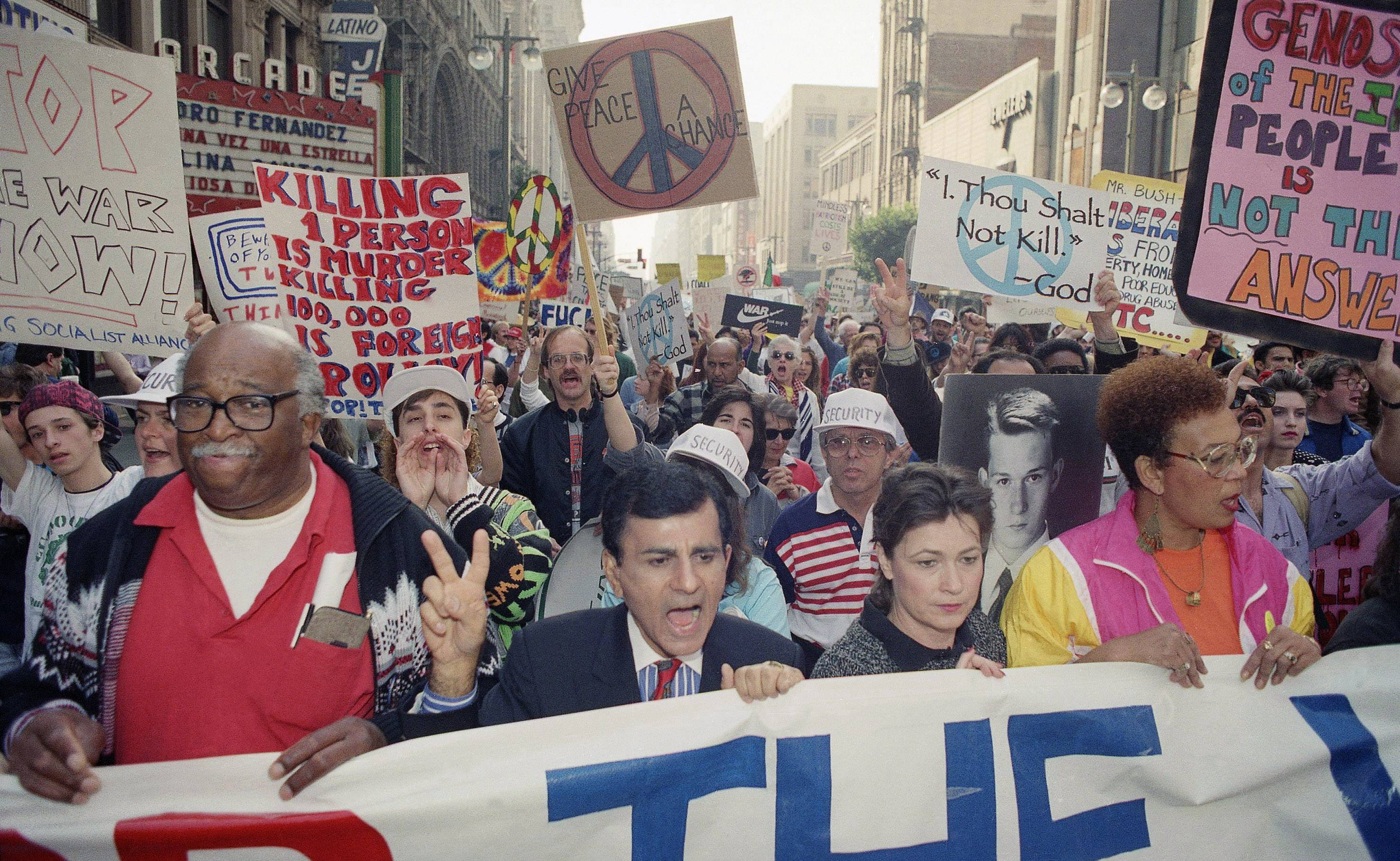 In this Jan. 26, 1991, file photo, entertainer Casey Kasem leads a group estimated at 15,000 people through the streets in Los Angeles protesting the United States' involvement in the Persian Gulf.