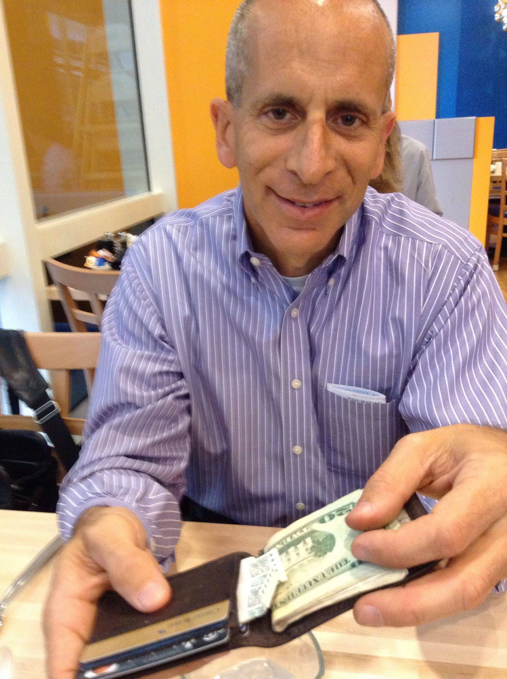 Illinois Fatherhood Initiative founder David Hirsch shows off the Band-Aid he's kept in his wallet since his kids were young. It's such a simple fathering tip, but it develops the idea that Dad is somebody to turn to when help is needed.