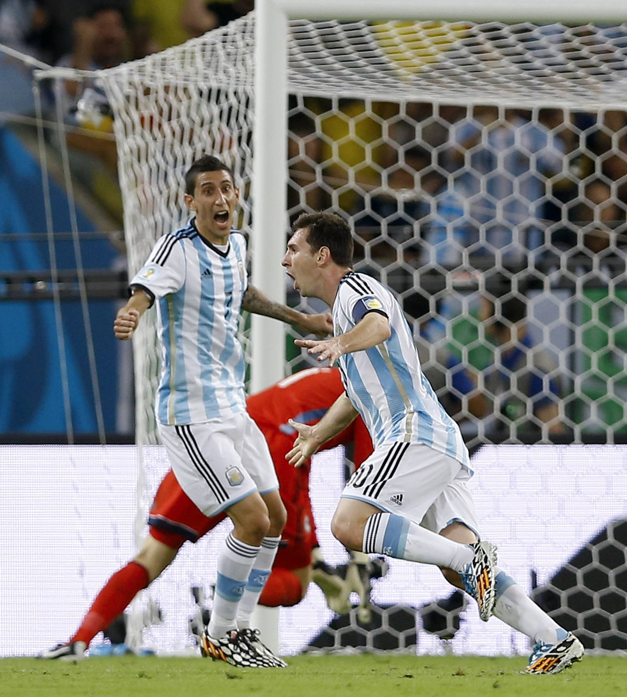 Argentina's Lionel Messi, right, celebrates with Argentina's Angel di Maria, left, after Messi scored his side's second goal during a group F World Cup soccer match between Argentina and Bosnia at the Maracana Stadium in Rio de Janeiro, Brazil, Sunday, June 15, 2014.