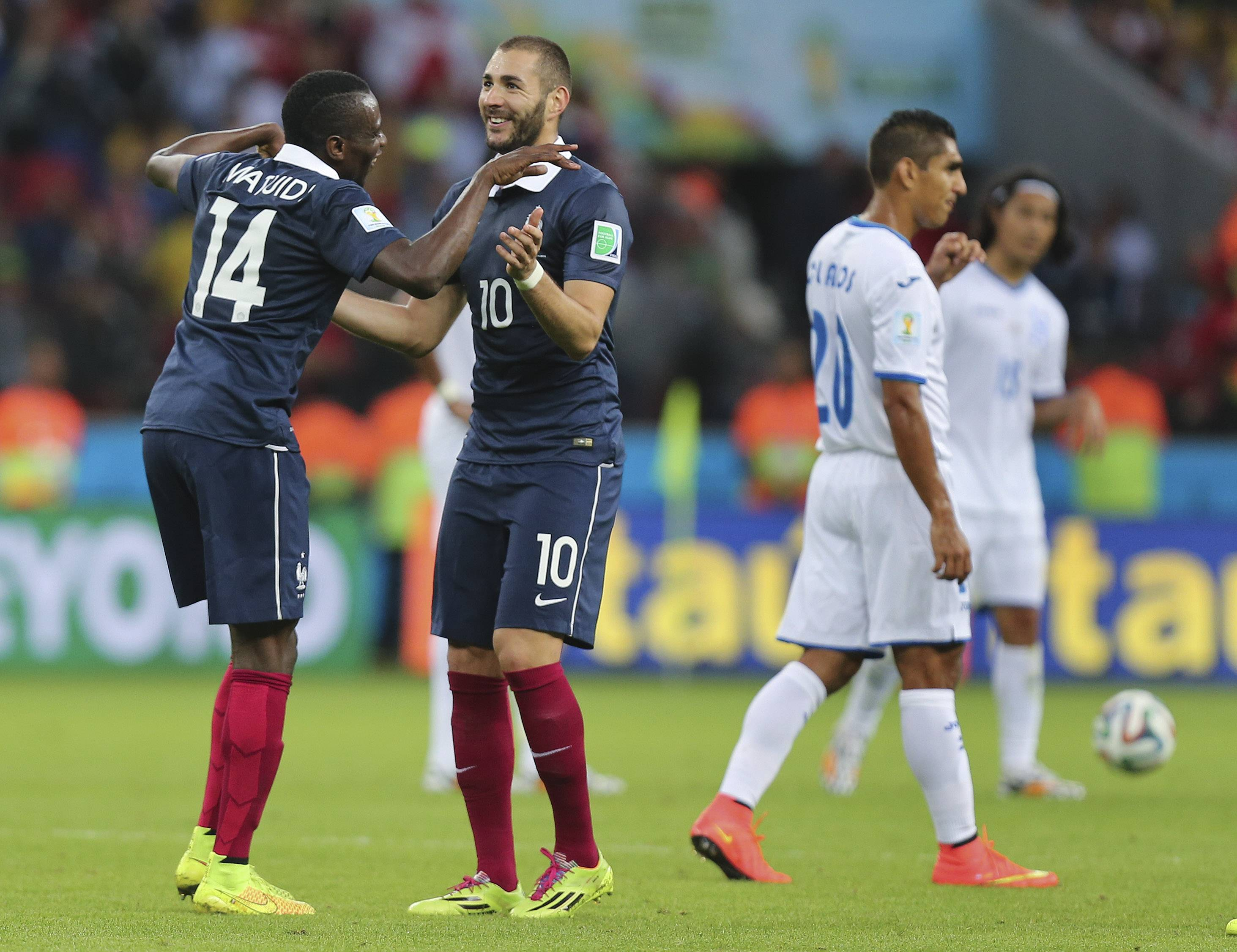 France's Karim Benzema (10) dances with Blaise Matuidi (14) after scoring the third goal during the group E World Cup soccer match between France and Honduras at the Estadio Beira-Rio in Porto Alegre, Brazil, Sunday, June 15, 2014.