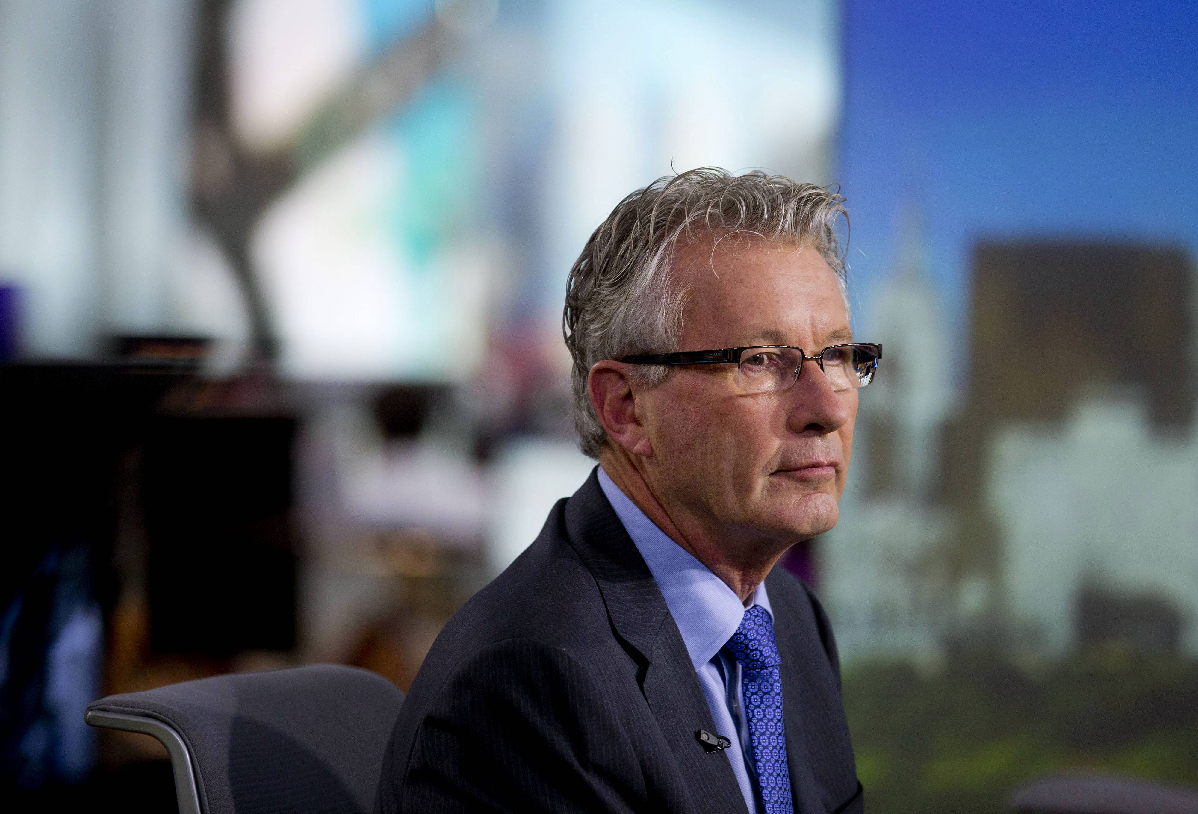 Nigel Travis, chief executive officer of Dunkin' Brands Group Inc., listens to a question during a Bloomberg Television interview in New York, U.S., on Friday, June 6, 2014.