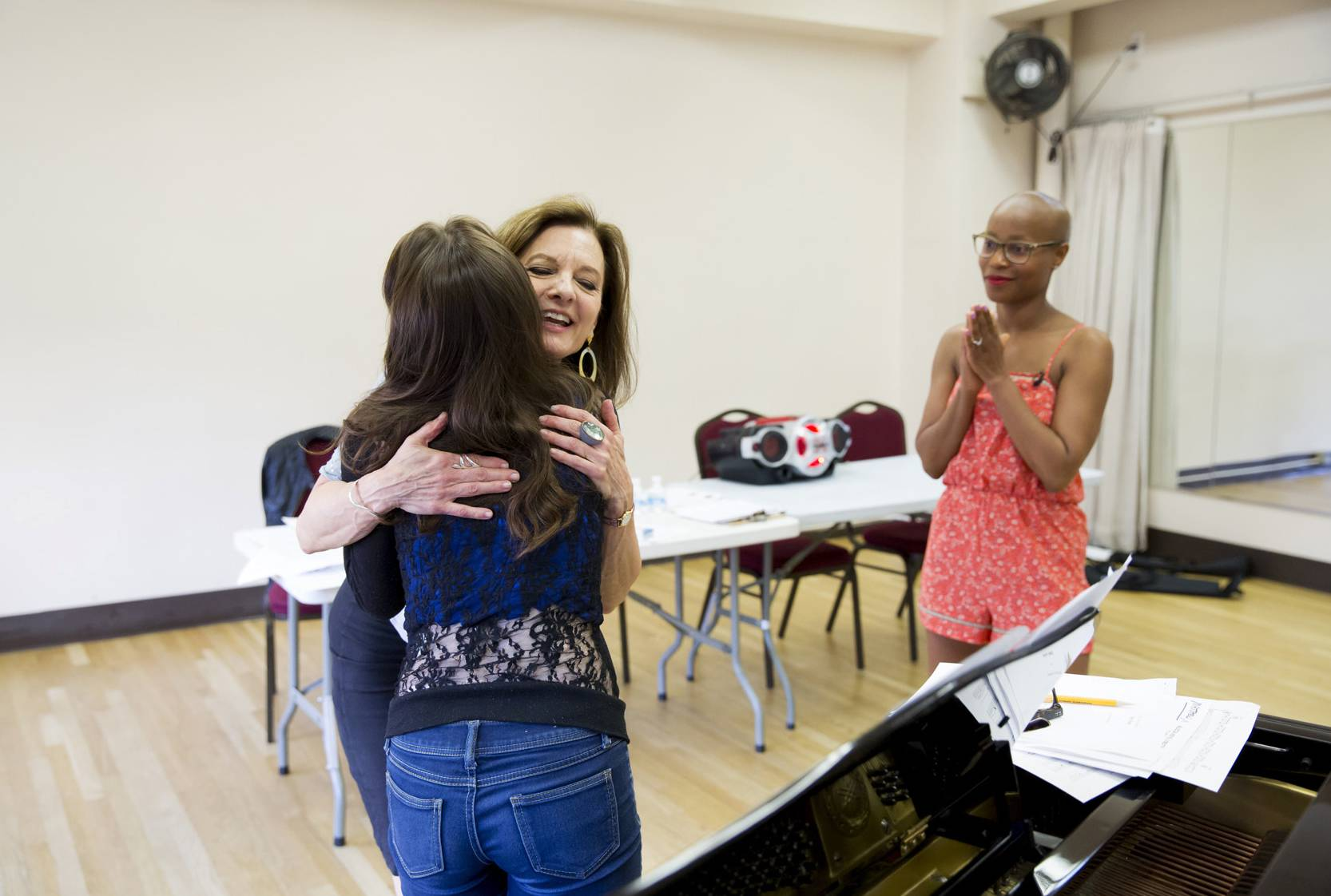 "Brittany DeLuca, left, 16, gets a hug from Marishka Wierzbicki, a master vocal coach, after performing ""Only Hope"" by Mandy Moore. The teen was mentored by Wierzbicki and Tony Award-nominee Valisia LeKae, right, ahead of the annual Garden of Dreams talent show."