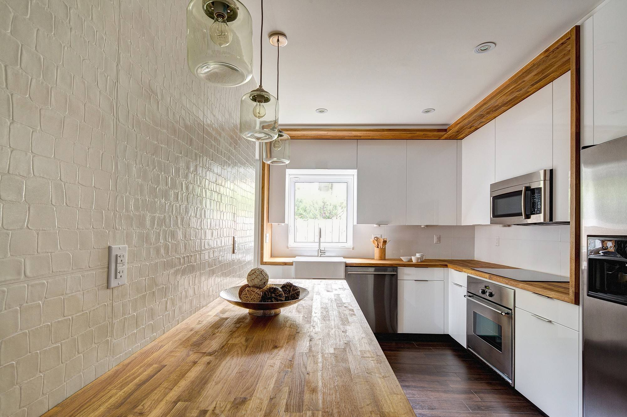 This contemporary kitchen won second place in the NKBA Design Competition's small-kitchen category. It was designed by German Brun of Den Architecture.