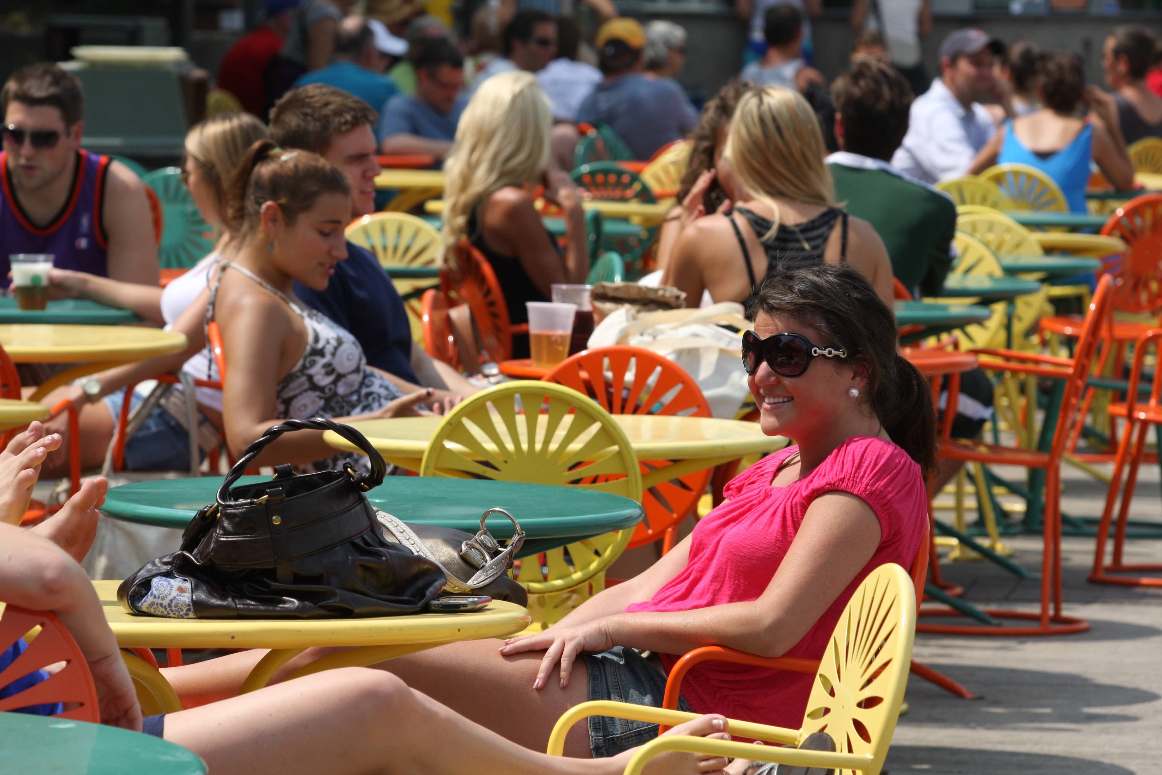 A crowd relaxes at Memorial Union Terrace in Madison, Wis. The terrace on State Street by the University of Wisconsin campus is a popular destination, almost like the city's back porch, with metal chairs for relaxing, hanging out and looking at Lake Mendota.