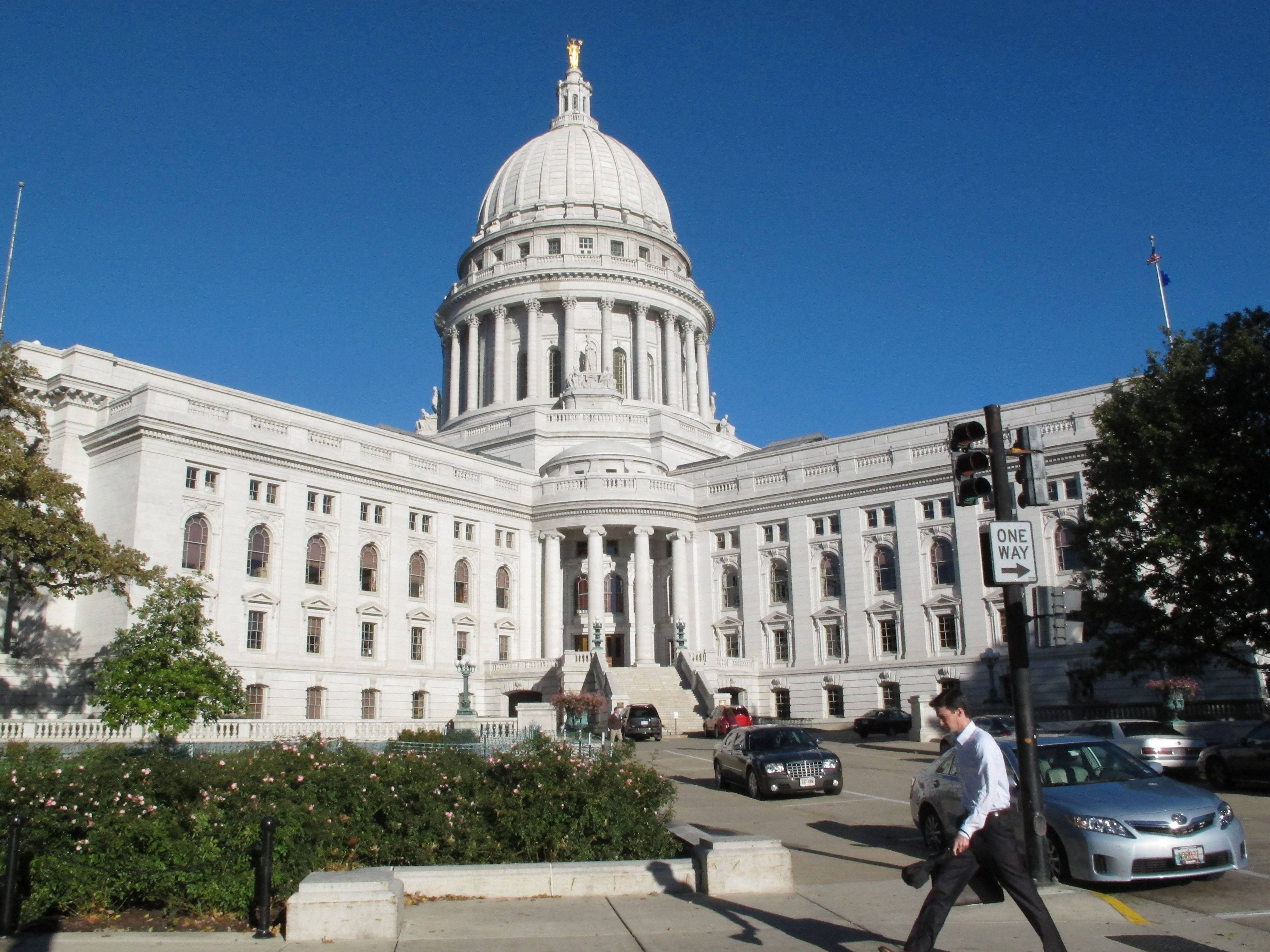 The state Capitol, the highest point of Madison's modest skyline at just over 284 feet, marks both the geographic and cultural center of the city.