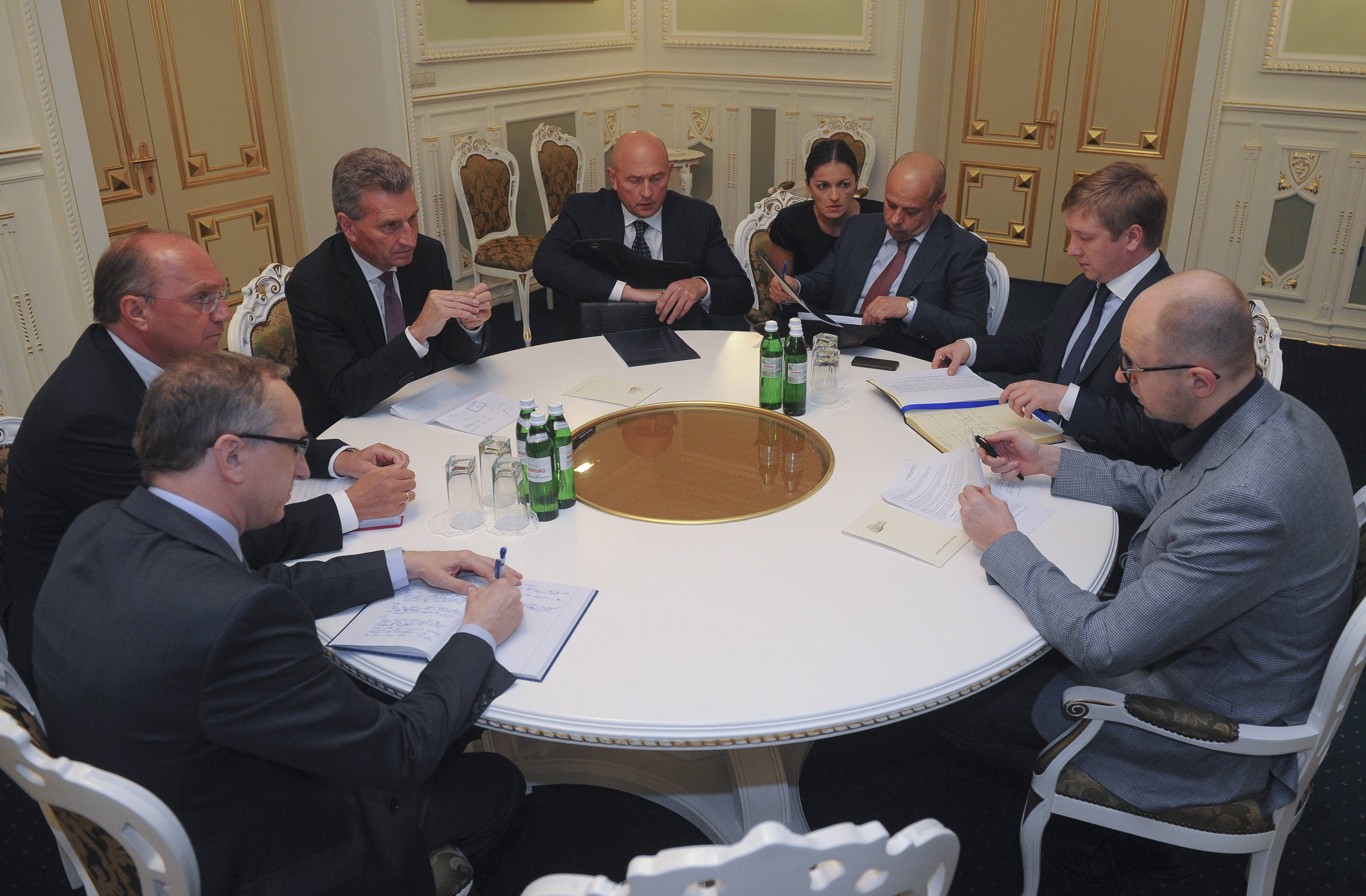 Energy Commissioner Guenter Oettinger, third left, talks with Ukrainian Prime Minister Arseniy Yatsenyuk, right, and his ministers at a round table discussion in the Ukrainian Cabinet in Kiev, Ukraine.