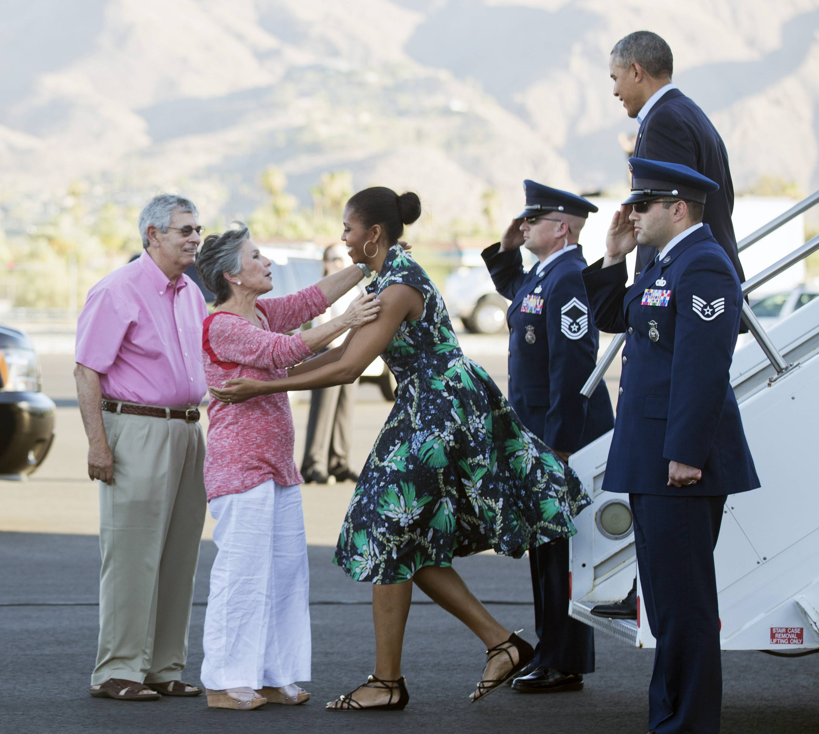 President Barack Obama and first lady Michelle Obama, are greeted on the tarmac by Sen. Barbara Boxer, D-Calif., second from left, and her husband Stewart Boxer, left, as they arrive on Friday in Palm Springs, Calif. -- where the Obamas escaped on vacation for Father's Day weekend.