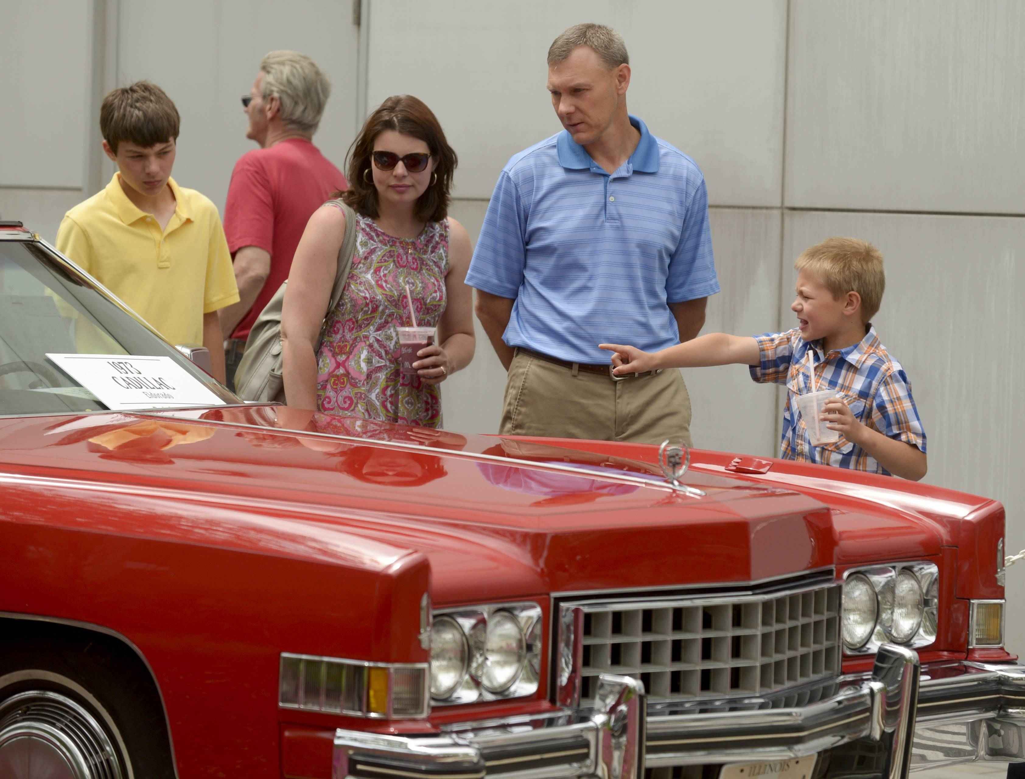 The Nicholaus family of La Grange Park -- Christina and Bret with sons Grant, 14, left, and Luke, 7 -- inspect a 1973 Cadillac Eldorado during the 46th annual Father's Day Classic Car Show on Sunday at Oakbrook Center.