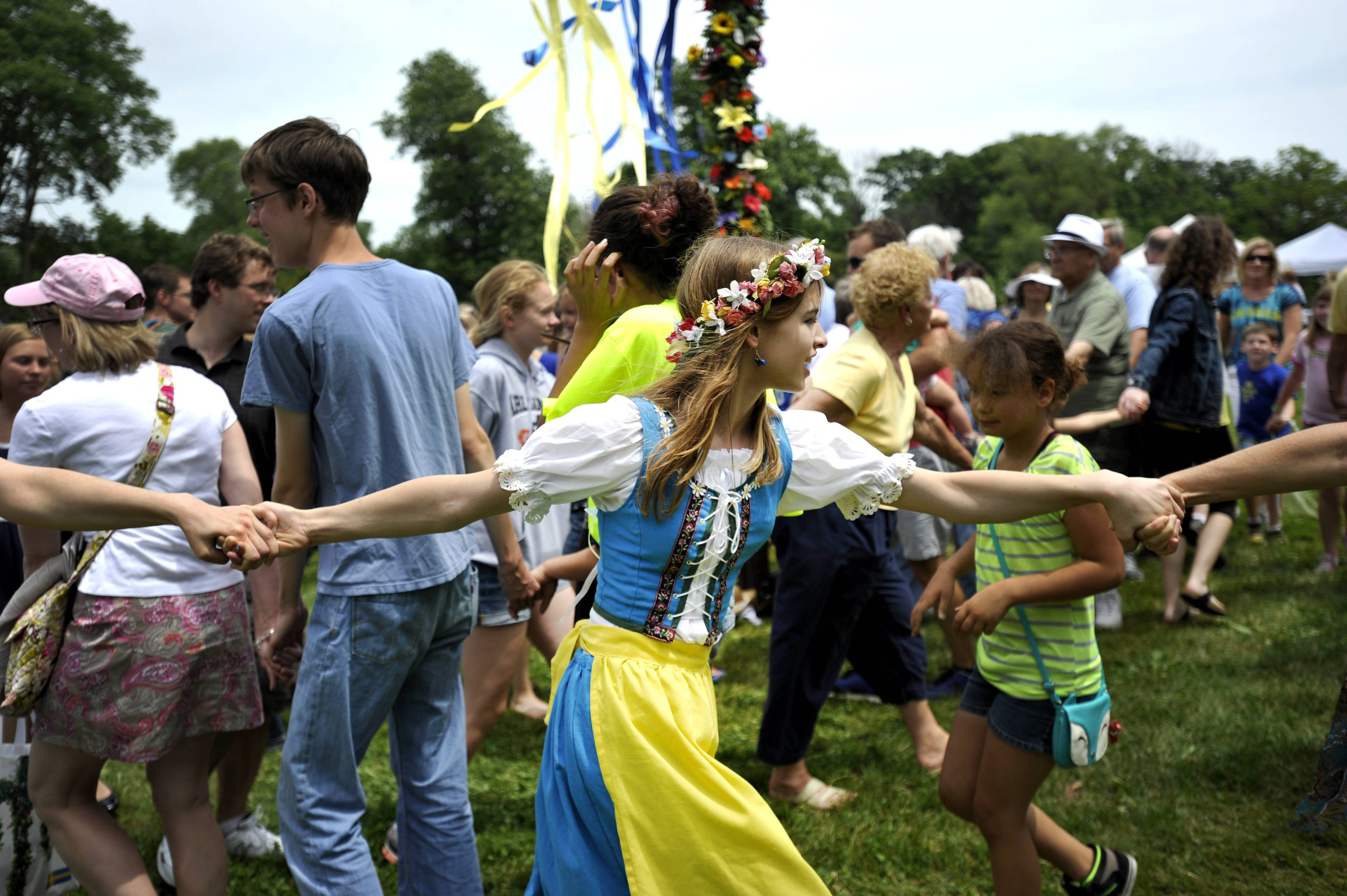 Alex Lewis, 13, of Naperville, participates in the Maypole dances Sunday at the 104th annual Swedish Day Midsommar Festival in Geneva. The Maypole dances are one of the highlights of the annual Swedish festival, and some participants wear authentic traditional Swedish clothing.