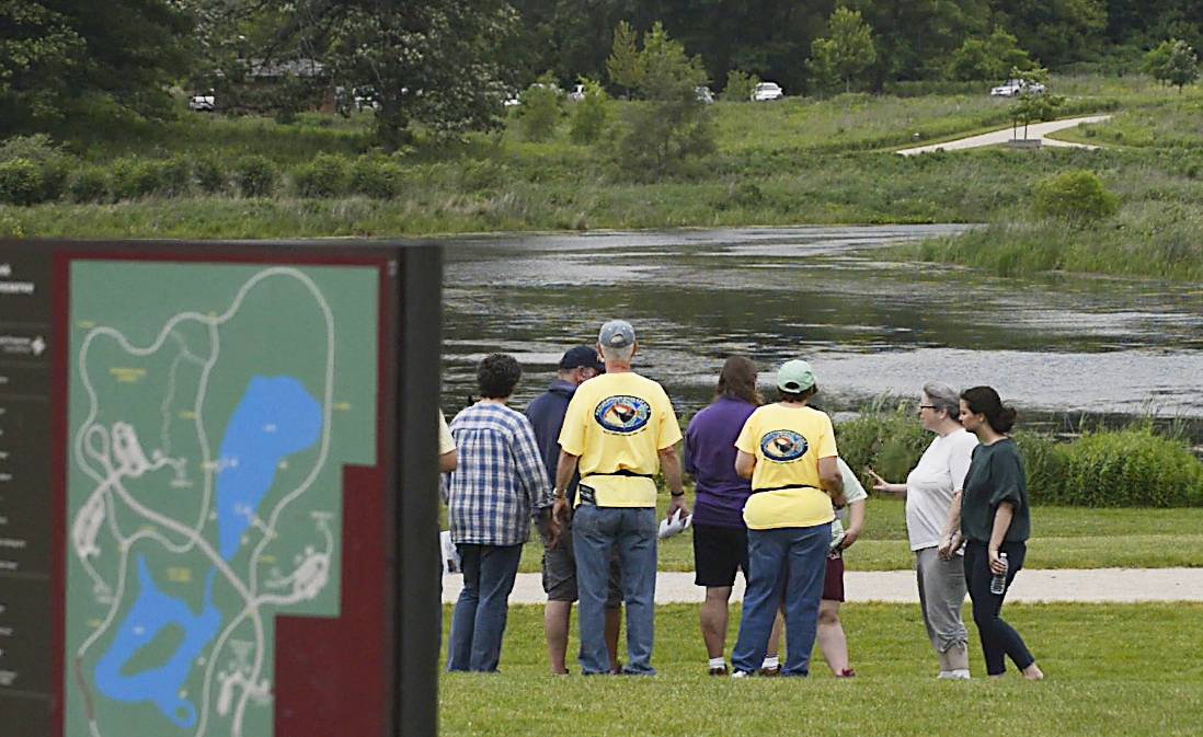 After meeting Sunday at Joy Lutheran Church in Gurnee, a group of searchers starts looking for clues to the disappearance of Andy Adler at the Nippersink Forest Preserve near Hainesville. Adler disappeared Sunday, June 8, after saying he was going for a bike ride.