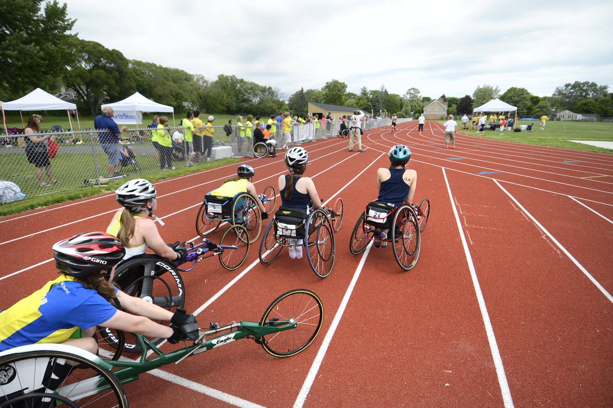 Athletes stage for a sprint race at the Great Lake Adaptive Sports Association 2014 Adult Regional Games at Lake Forest High School Sunday.