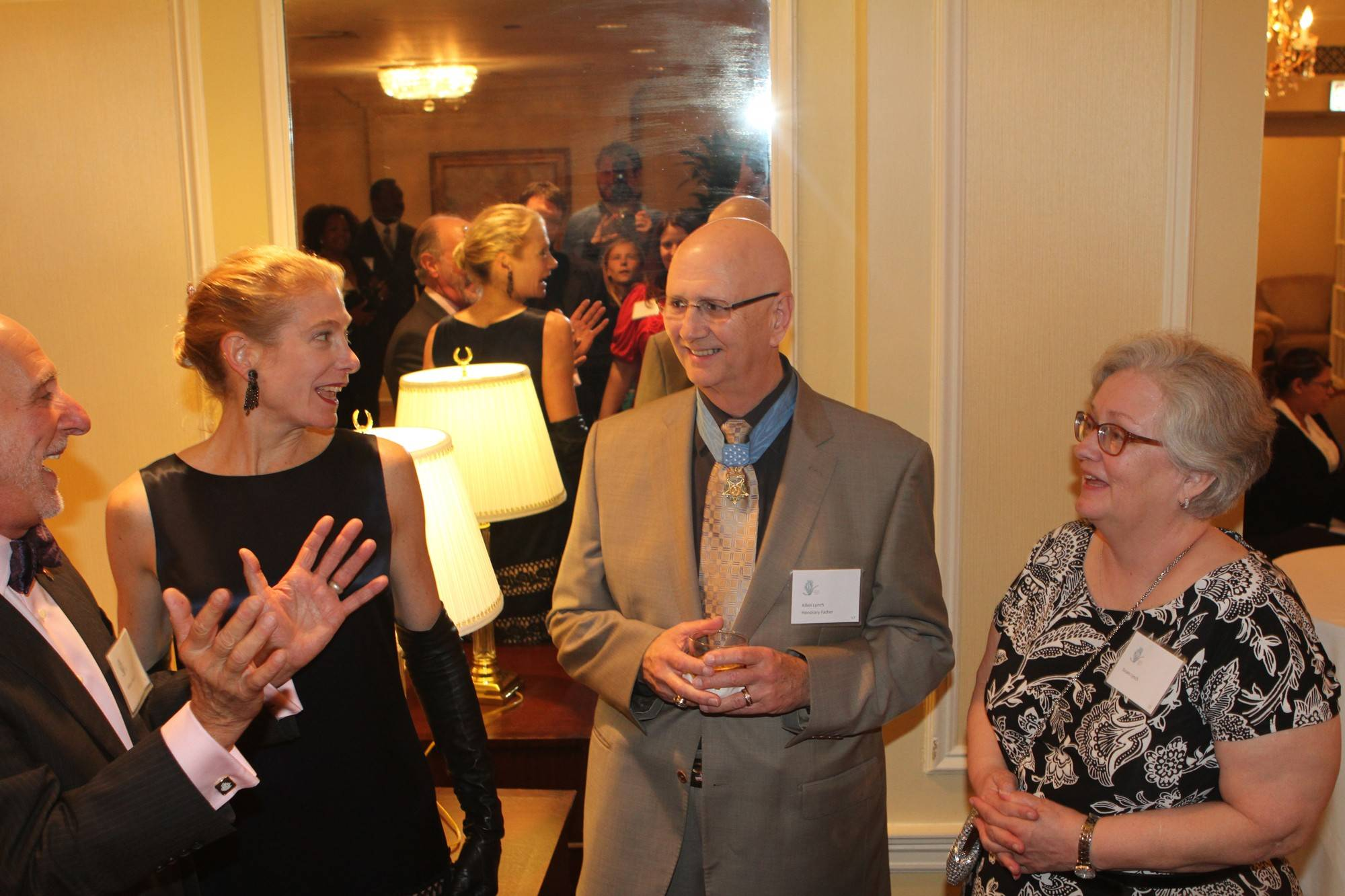 A 2014 Father of the Year, Gurnee's Allen Lynch, wearing the Medal of Honor he received during the Vietnam War, and his wife, Susan, right, greet well-wishers at the Illinois Fatherhood Initiative's annual awards dinner.