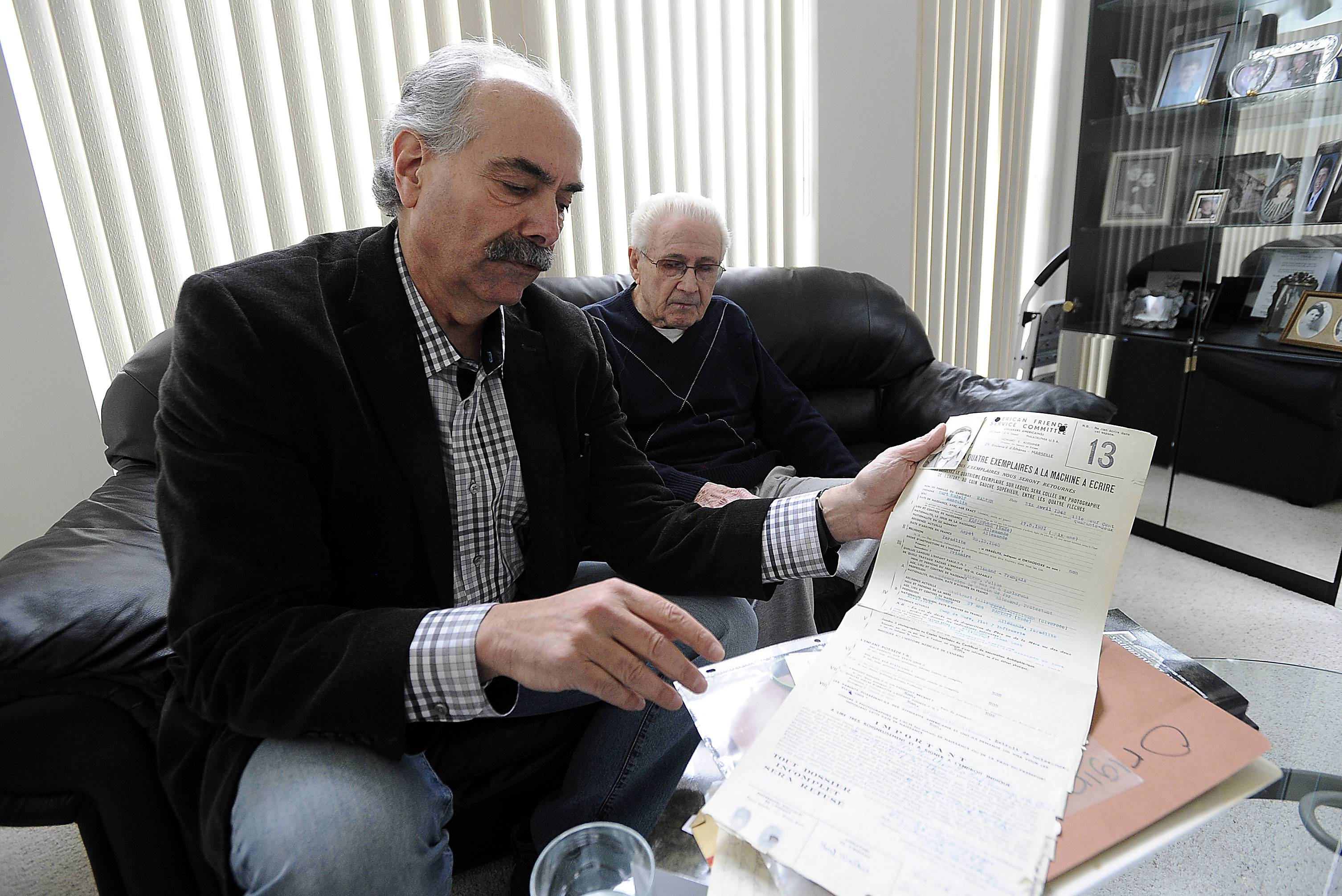 Author Steve Richards holds the paperwork and picture of Kurt Wagner at age 10 years old when his mother signed these papers to send him out of camp and in turn saved his life.