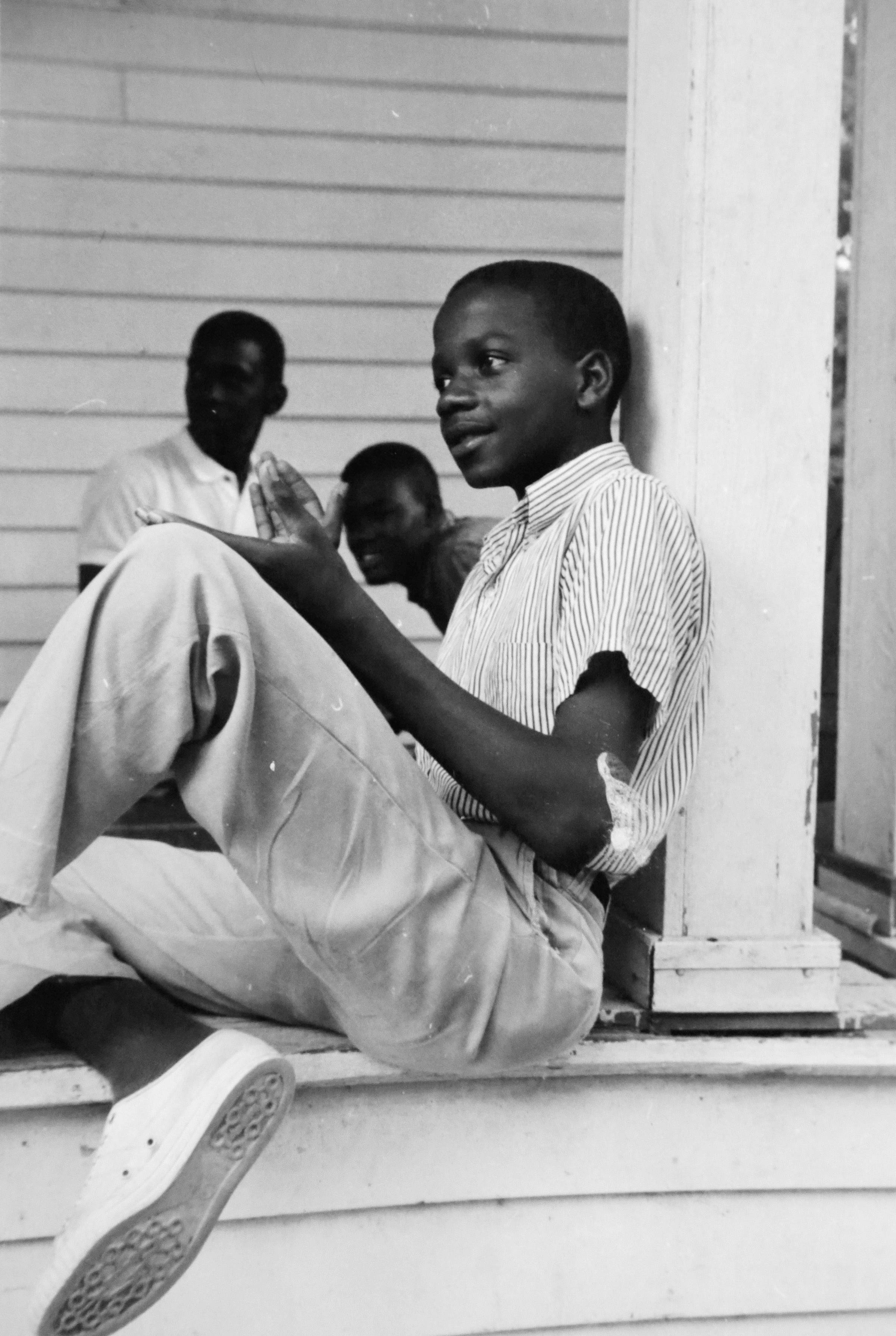 "This 1964 photo, provided by Michael Clurman, shows Roy DeBerry at a ""Freedom School"" in Holly Springs, Miss. DeBerry, nicknamed ""Shorty"" by his classmates, said that he liked how Aviva Futorian, a young history teacher and volunteer at the school, ""took my views seriously, even though I was a very young person."" It was his first interaction with a white person ""on a social level."""