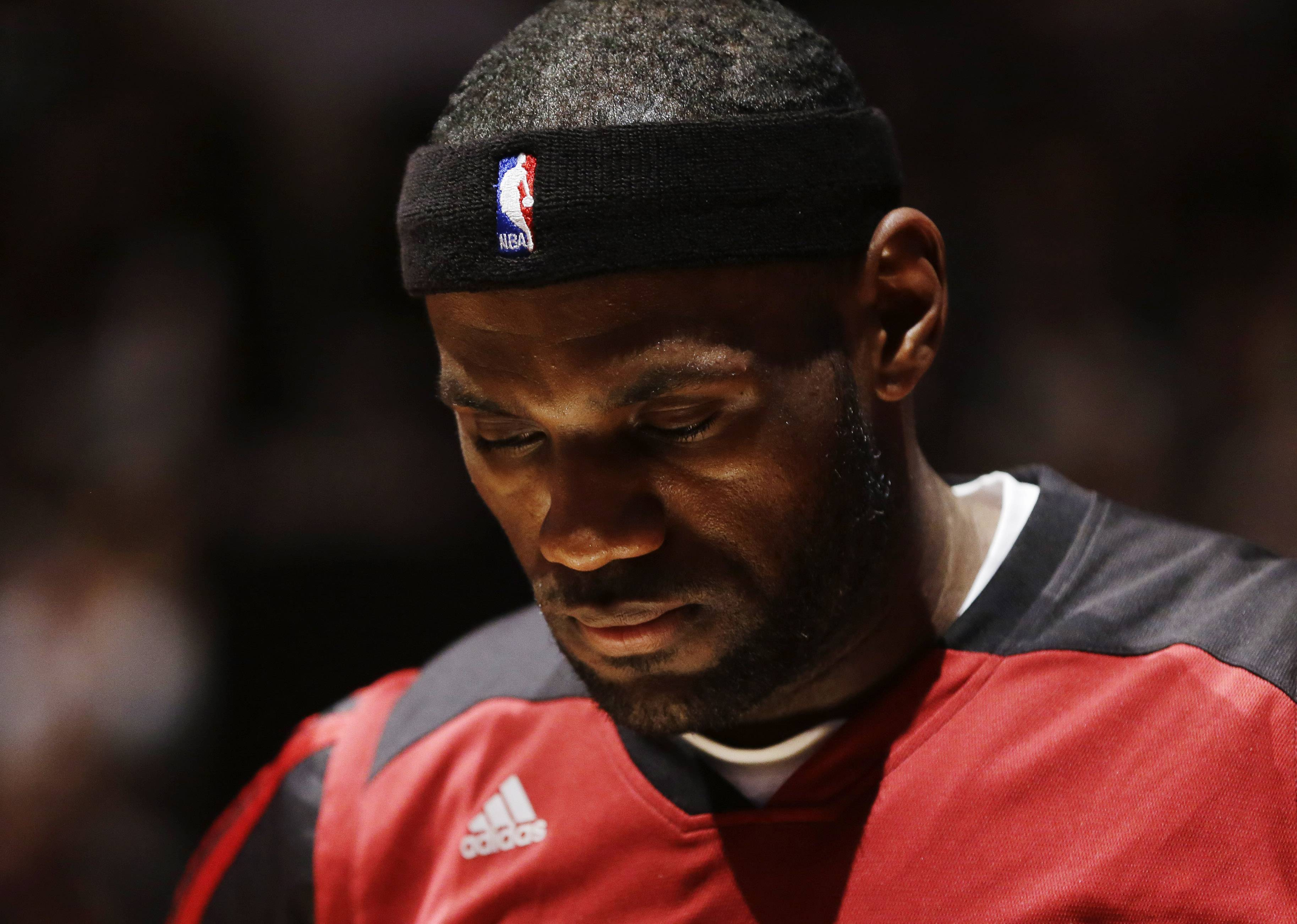 Miami Heat forward LeBron James waits for the beginning of Game 5 of the NBA basketball finals against the San Antonio Spurs on Sunday, June 15, 2014, in San Antonio.