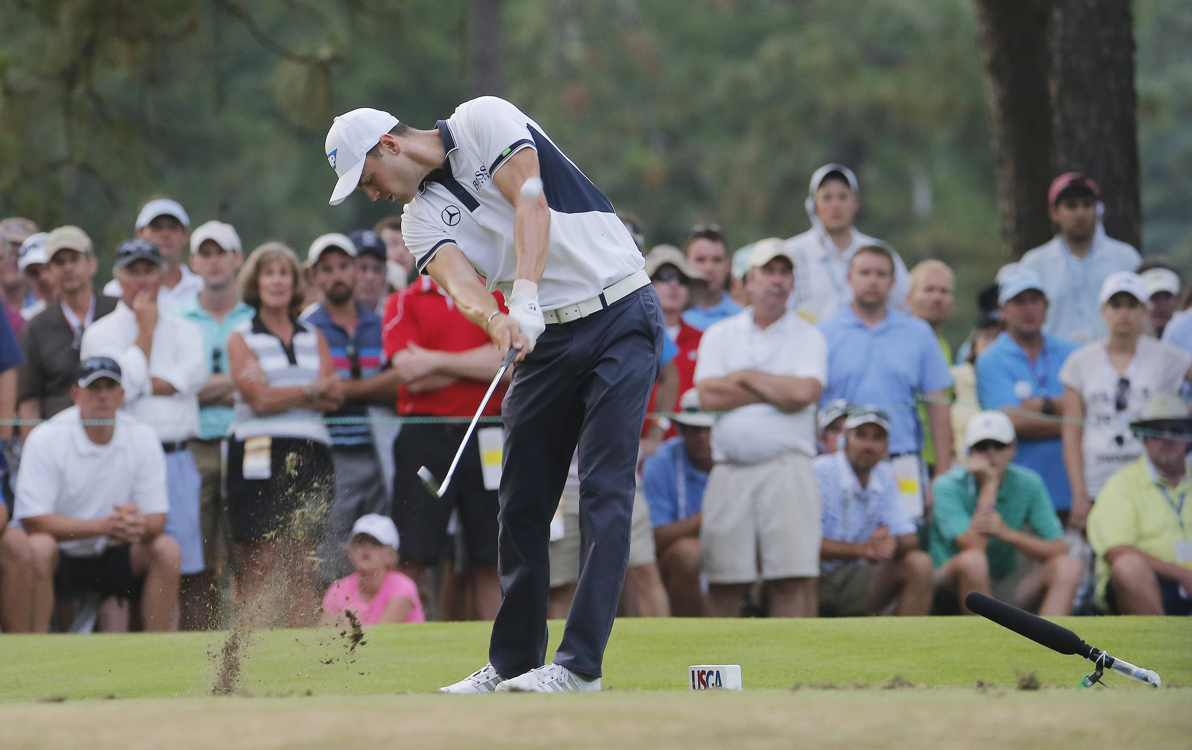 Martin Kaymer, of Germany, hits his tee shot on the 17th hole during the final round of the U.S. Open golf tournament in Pinehurst, N.C., Sunday, June 15, 2014.