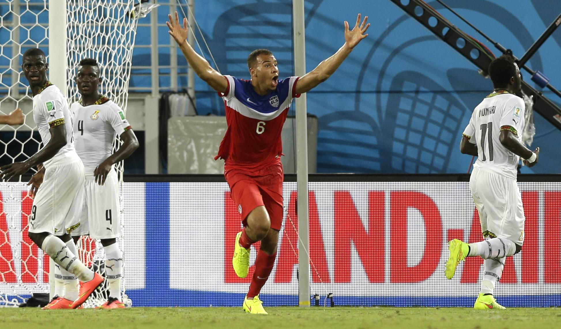 United States' John Brooks, center, celebrates after scoring his side's second goal during the group G World Cup soccer match between Ghana and the United States at the Arena das Dunas in Natal, Brazil, Monday.