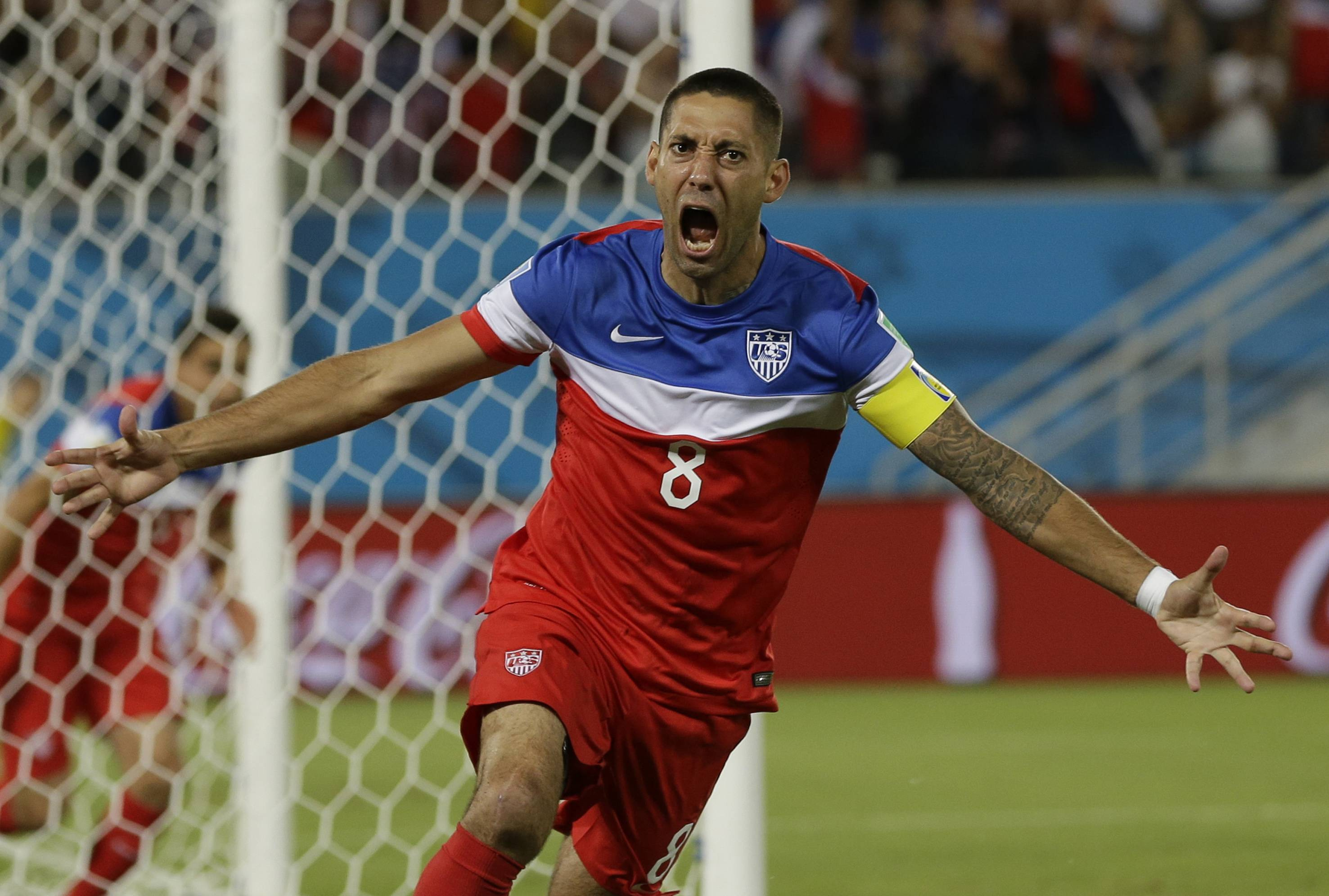 United States' Clint Dempsey celebrates after scoring the opening goal — just 32 seconds into the match — during the group G World Cup soccer match between Ghana and the United States at the Arena das Dunas in Natal, Brazil, Monday.