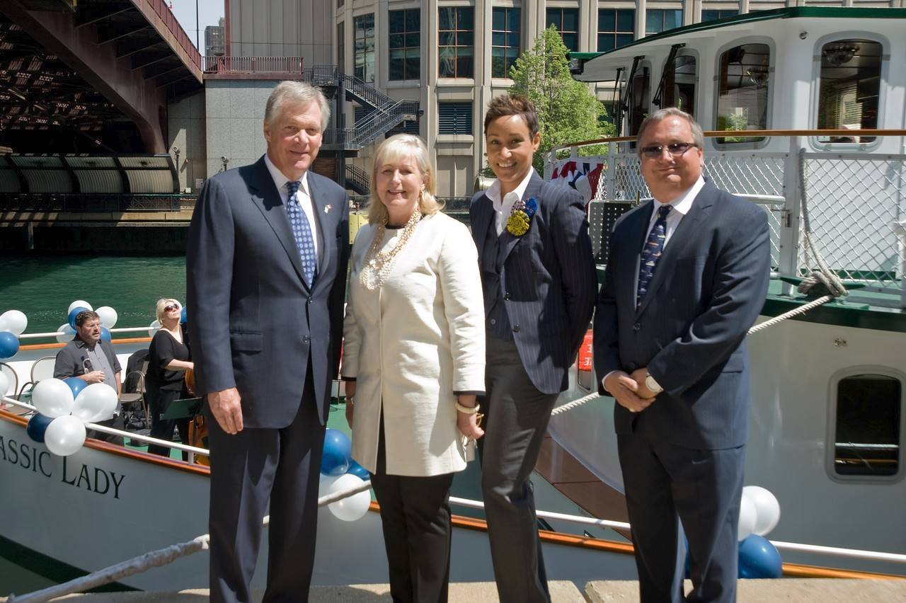 Douglas Oberhelman, CEO, Caterpillar Inc., from left Holly Agra, president, Chicago's First Lady Cruises; Desiree Rogers, CEO Johnson Publishing & chair of Choose Chicago; Captain Bob Agra, CFO Chicago's First Lady Cruises.