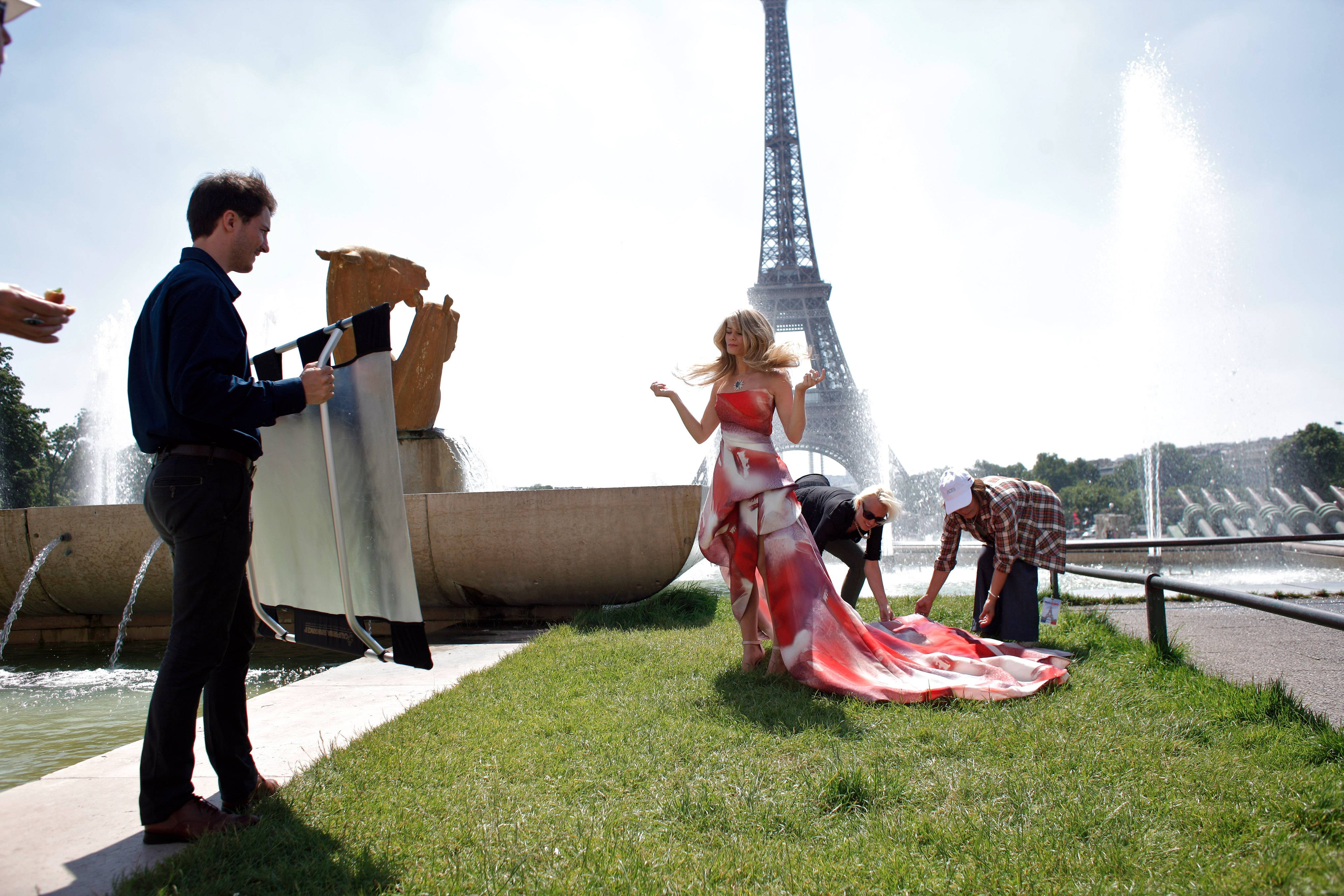 """The Bold and the Beautiful"" cast member Kimberly Matula, center, is prepared prior to filming a scene in the Trocadero gardens in Paris Friday. The U.S. series filmed a series of episodes in front of the Eiffel Tower to celebrate 25 years of being broadcast in France."