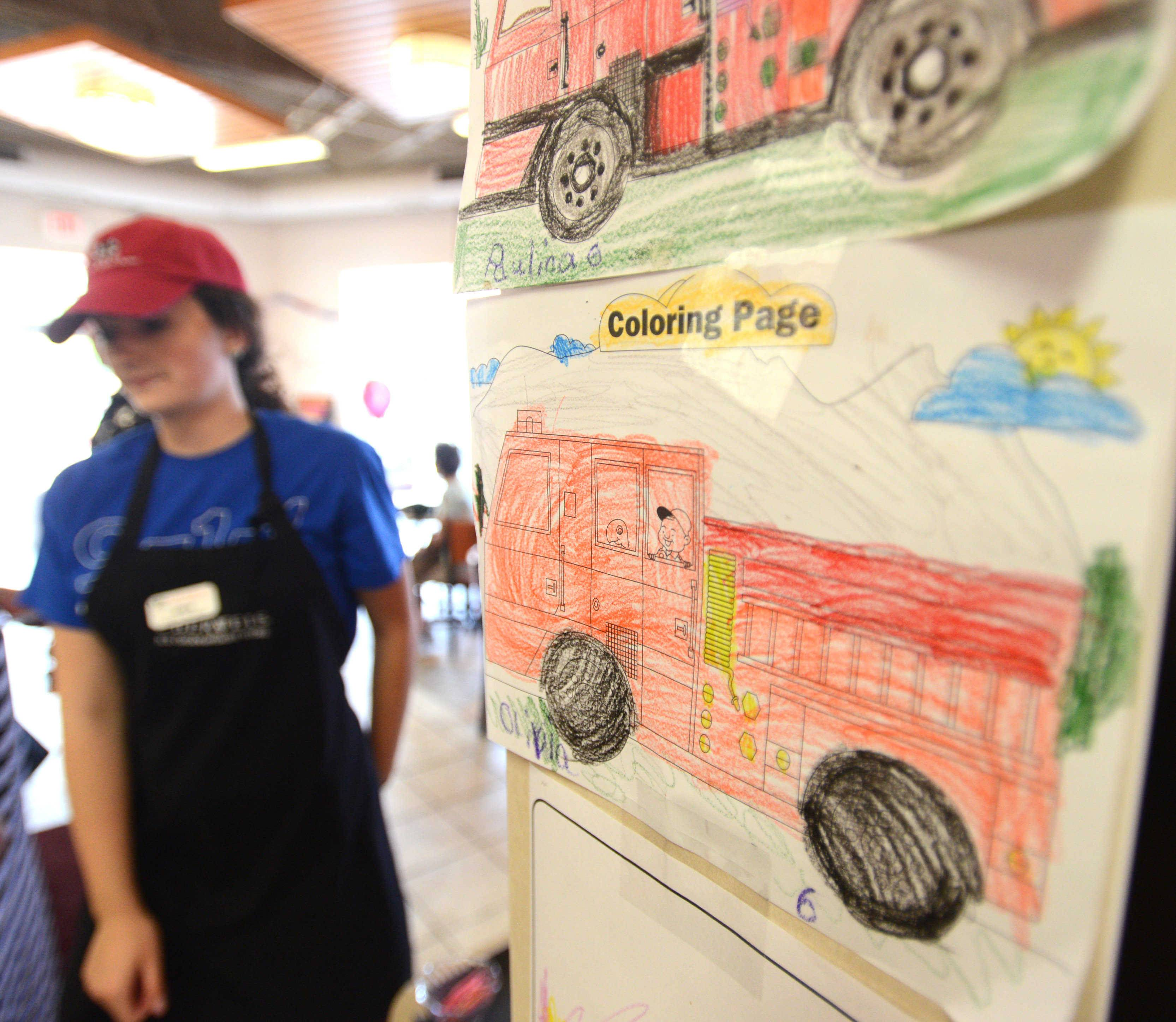 Monday's safety event featured coloring pages on the wall at the Oberweis Dairy store in Mount Prospect.
