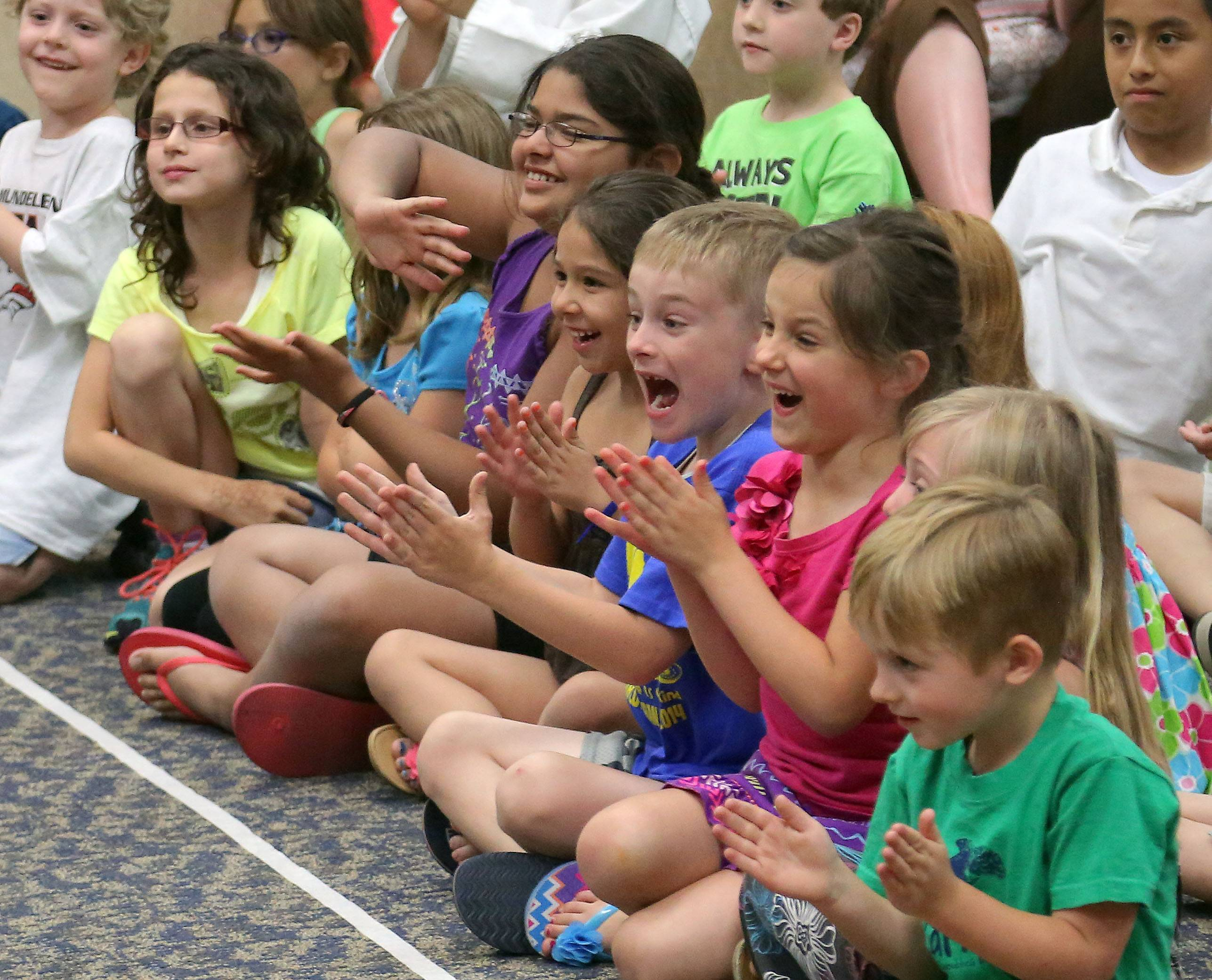 Kids cheer the canine performers Monday at Fremont Public Library in Mundelein.
