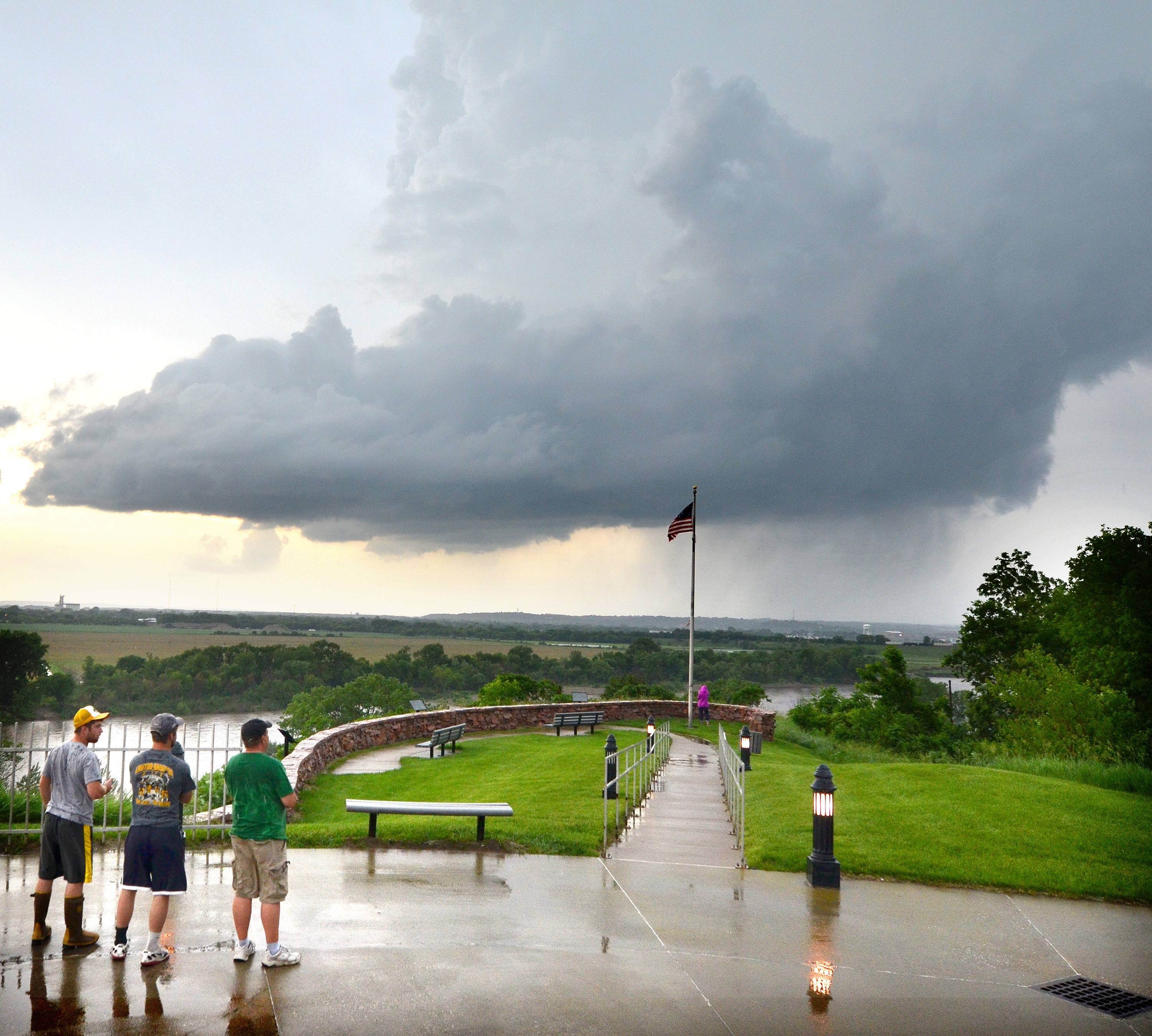 Onlookers standing at the Sgt. Floyd Monument in Sioux City, Iowa, watch as a storm cell passes over the city Monday, June 16, 2014. Storms were even worse Monday in Nebraska, where tornadoes killed at least 1 person.
