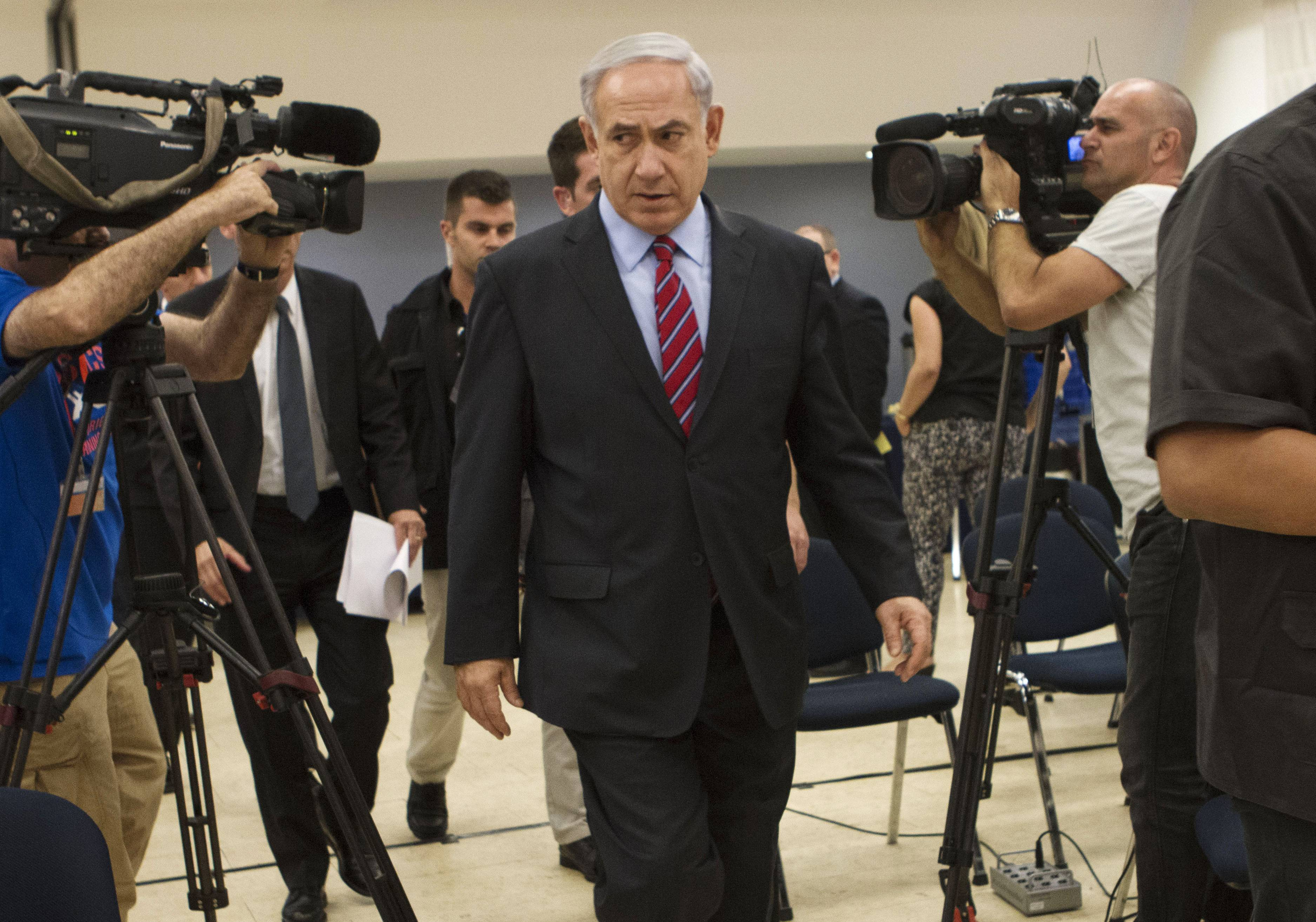 Israeli Prime Minister Benjamin Netanyahu leaves a press conference in Tel Aviv, Israel, Sunday, June 15, 2014. Netanyahu has condemned Palestinian President Mahmoud Abbas' agreement with the militant group, and said he would hold him responsible for the safety of the youths, who disappeared apparently while hitchhiking in the West Bank late Thursday.