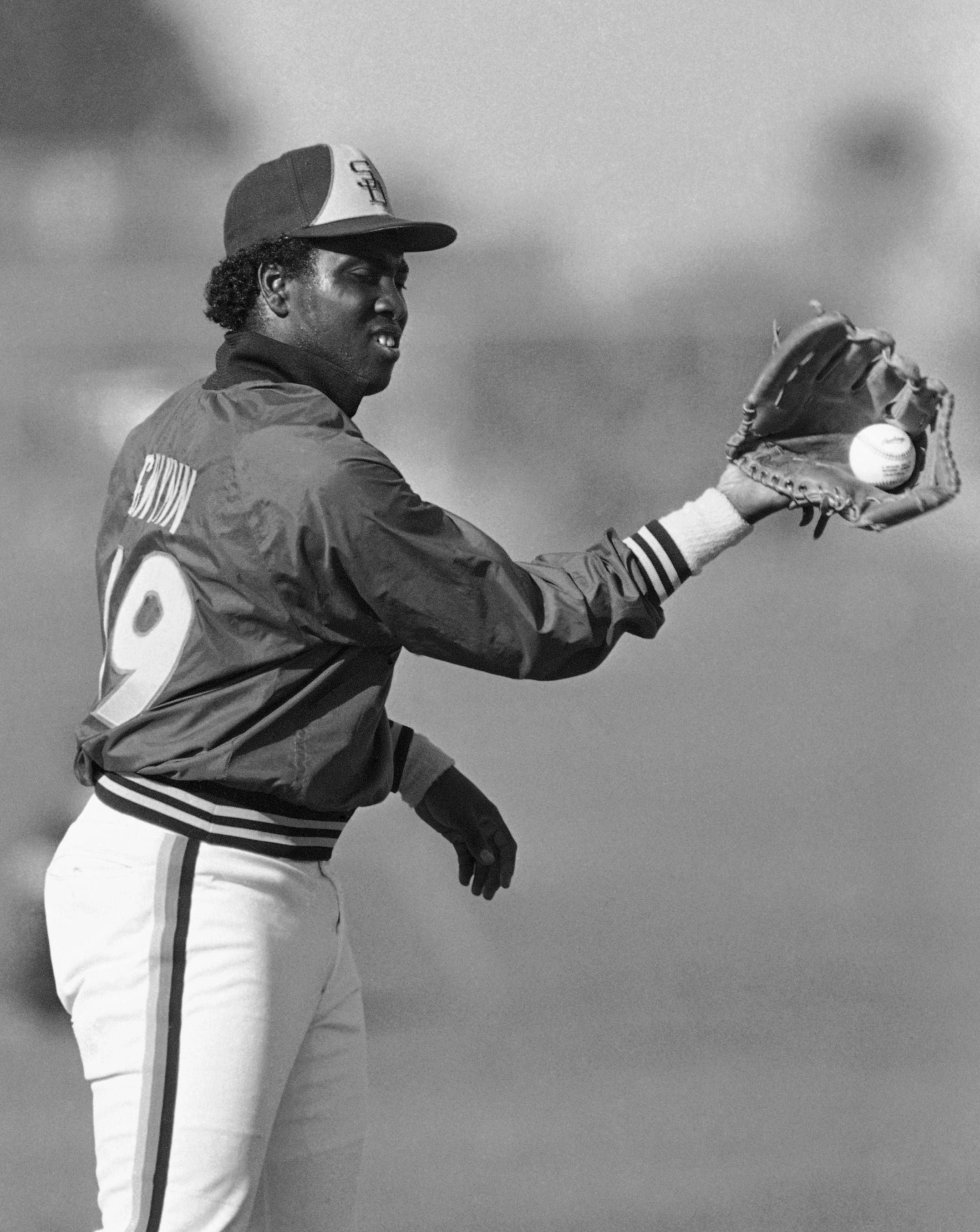 In this March 6, 1985 file photo, San Diego Padres' Tony Gwynn does a twist to make a back hand catch at the teams' spring training camp in Yuma, Ariz. Gwynn, the Hall of Famer with a sweet left-handed swing who spent his entire 20-year career with the Padres and was one of San Diego's most beloved athletes, died of cancer Monday, June 16, 2014. He was 54.