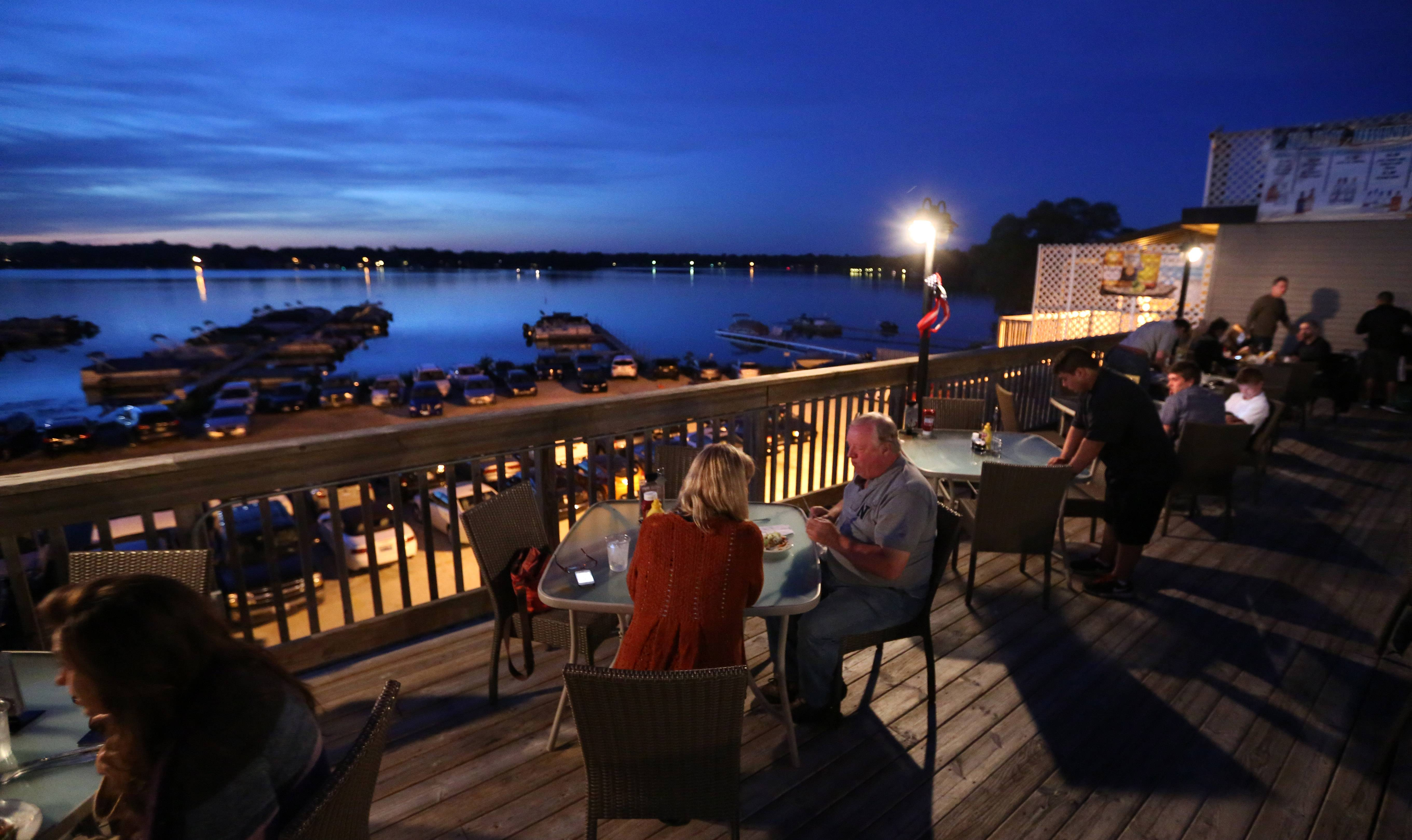 The outdoor dining area overlooking Bangs Lake at Docks Bar and Grill in Wauconda.