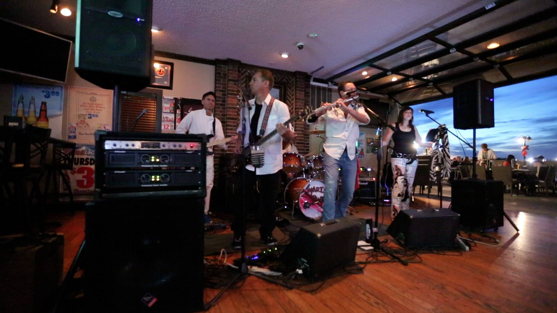 Kildeer-based band Smarty Pants -- with Steve Gezeler, left, playing lead guitar, Robert Touella playing bass, Mario Losacco on drums, Steve Dee playing the flute, and Anne Christy, lead singer -- plays at the Docks Bar and Grill in Wauconda.