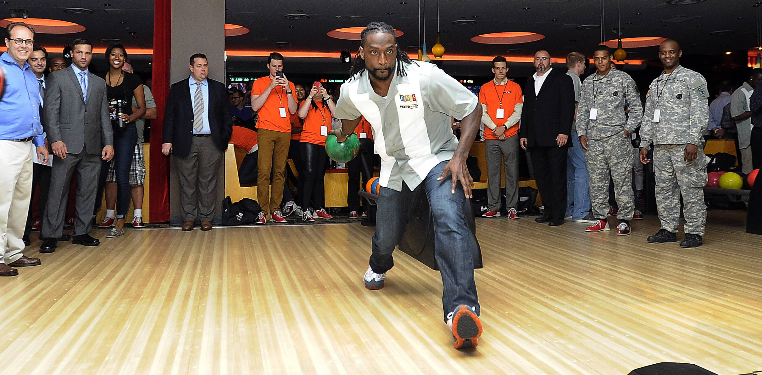 Chicago Bear Charles Tillman throws his bowling ball down the alley as he kicks off the third annual Charles Tillman Celebrity Pro Bowler Tournament at Kings Lanes in Rosemont on Thursday.