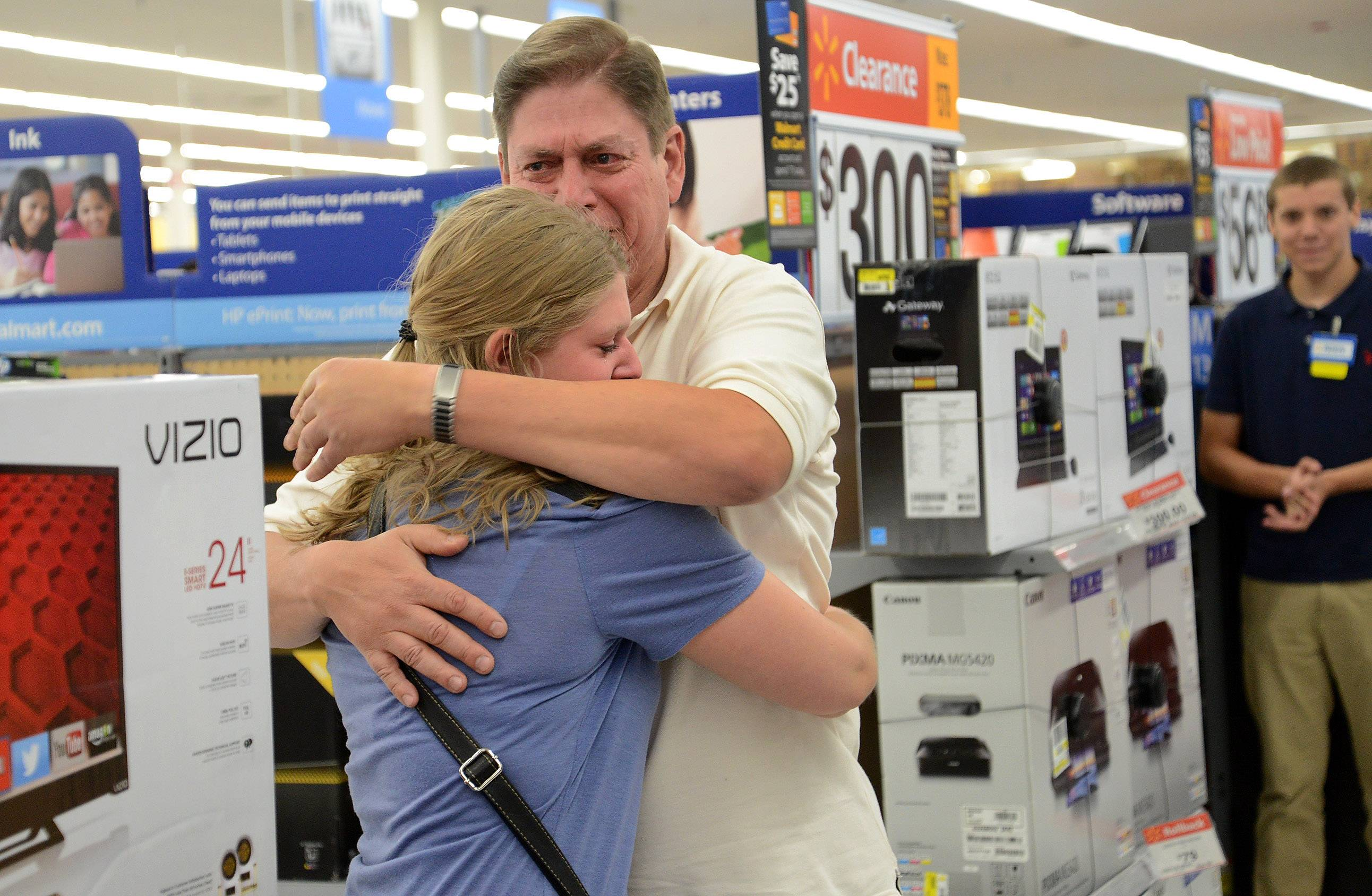 Michael Perrella, of Wheeling, is surprised at the Wheeling Walmart after his daughter Nicole's entry won him a national contest sponsored by Vizio.