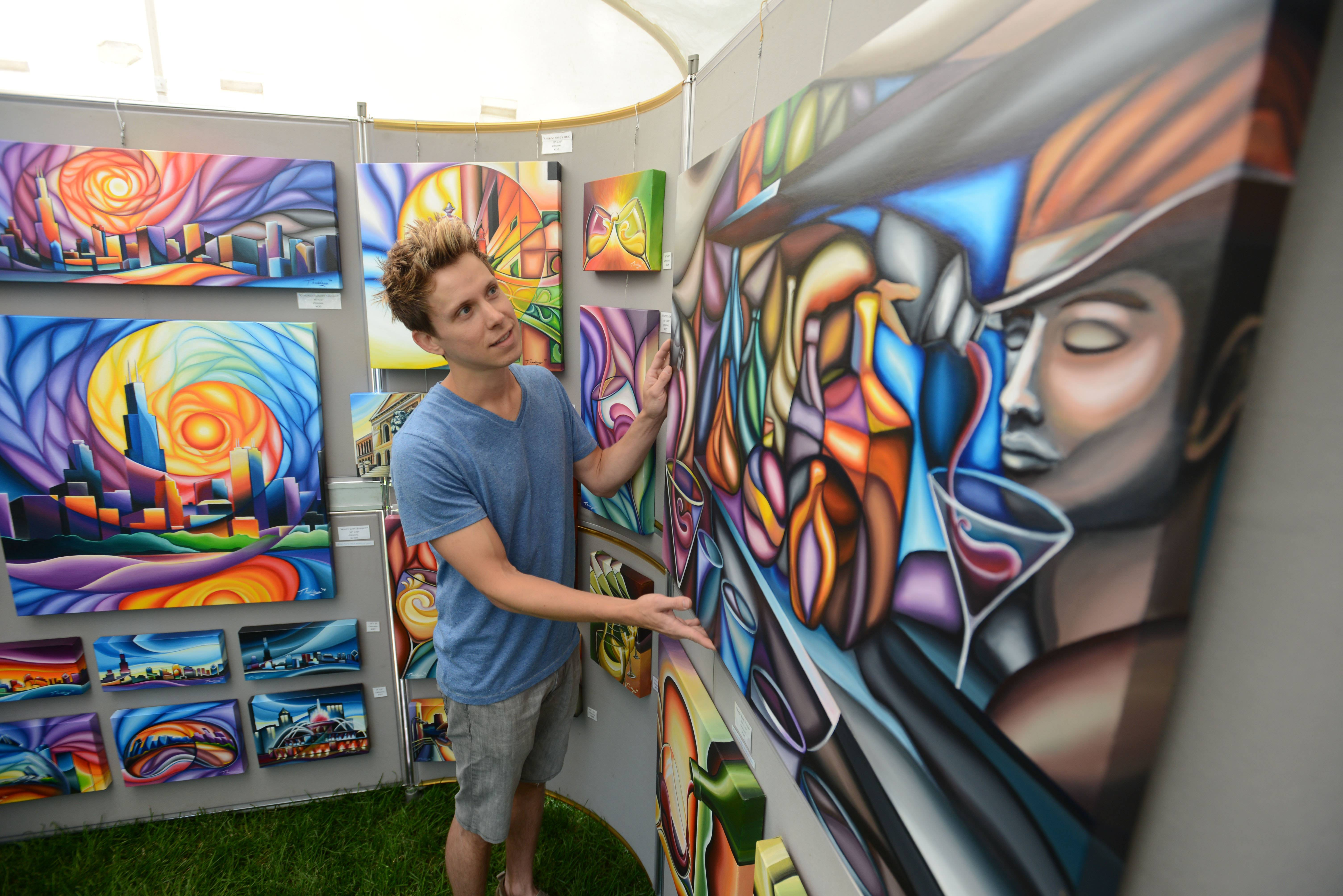 Peter Thaddeus, of Warrenville, adjusts his painting at the The Art in Bloom festival Saturday at Cantigny Park in Wheaton. The event included a juried art show with exhibiting artists, activities and crafts for kids, demonstrations, live music and food.