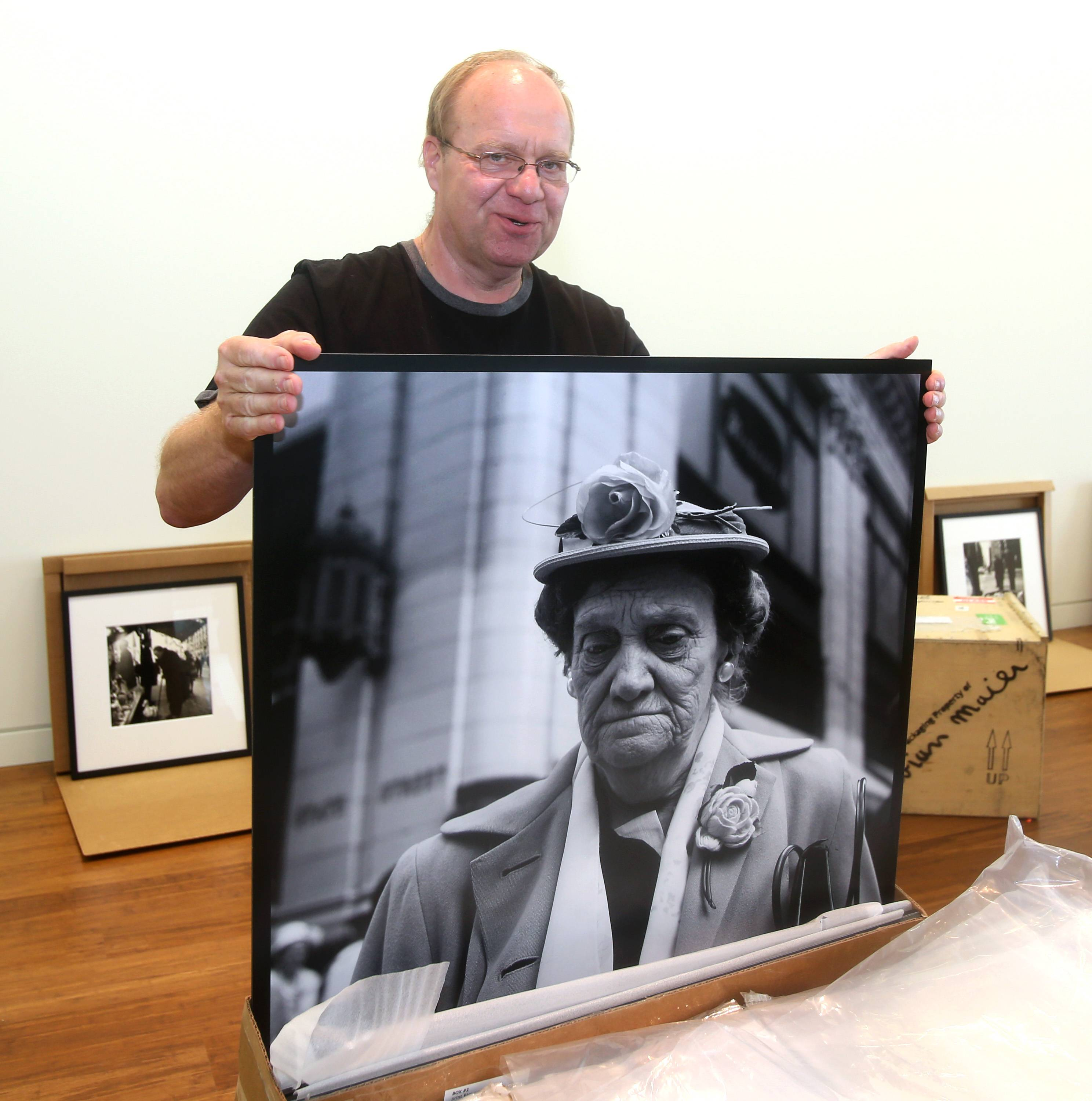 "The ""Vivian Maier: Exposed"" exhibit is opening June 17 in the Cleve Carney Art Gallery at the College of DuPage's  MacAninch Arts Center. Frank Jackowiak, COD program specialist/lab manager, unveils a print from the collection found in one of the 275 rolls of Maier's film he and several students developed."