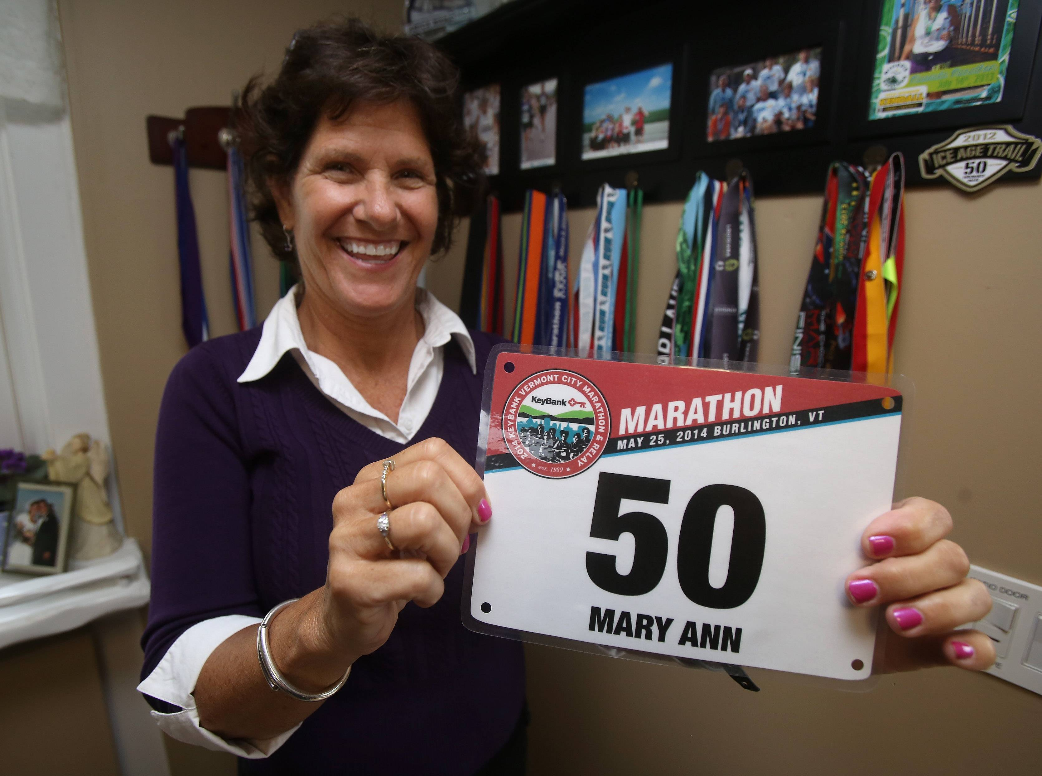 Libertyville runner Mary Ann Zemla displays the runner's number she had in her last race in Vermont. Zemla has run marathons in all 50 states, 74 marathons in all, and she's run the Chicago Marathon 13 times.