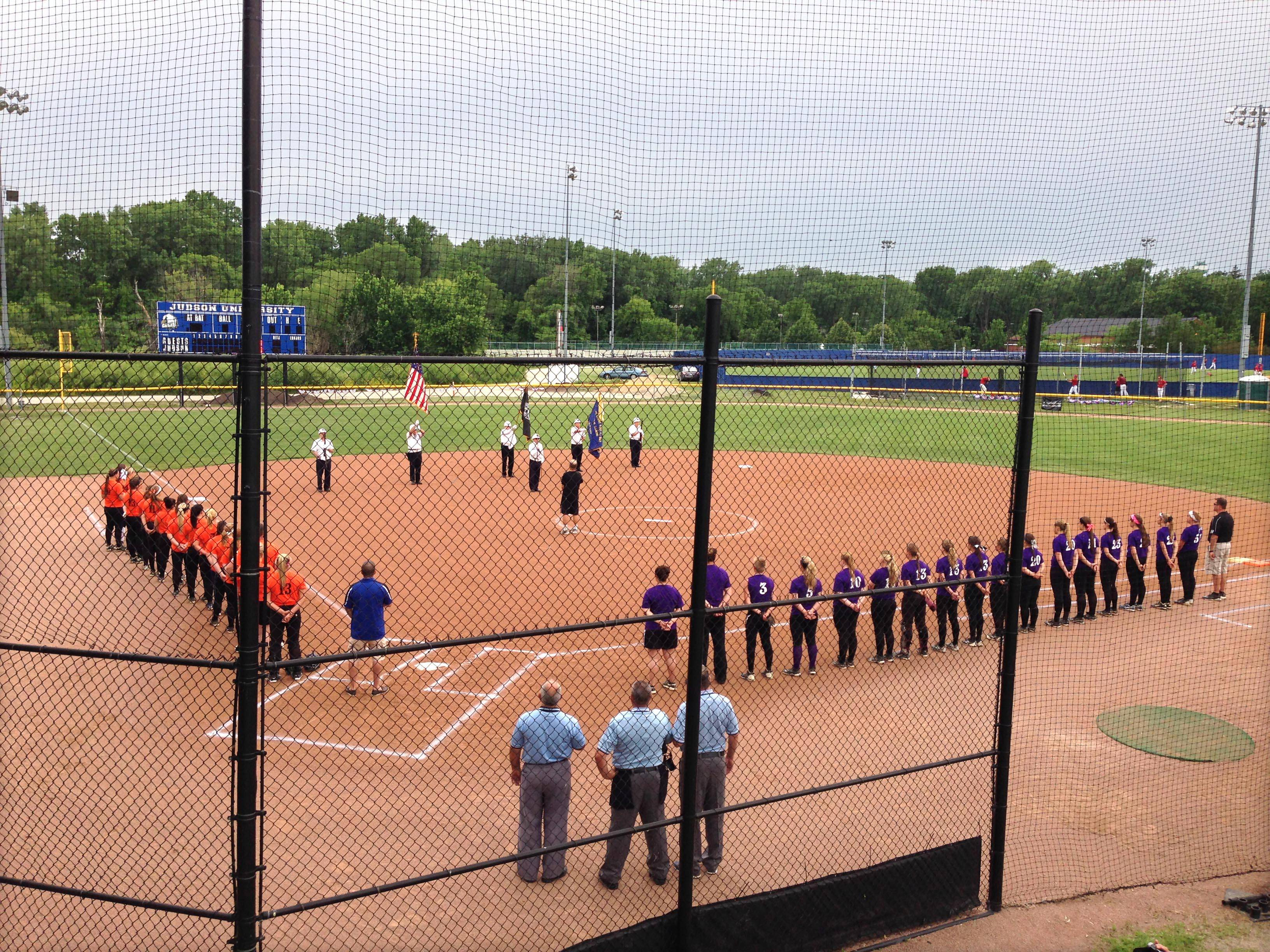 Two teams of high school softball all-stars line up on the basepaths as the colors are presented by the Haderer-Eineke American Legion Post 680 of Hampshire at the 11th Annual Fehlman Memorial Senior All-Star game at Judson University in Elgin Monday evening.
