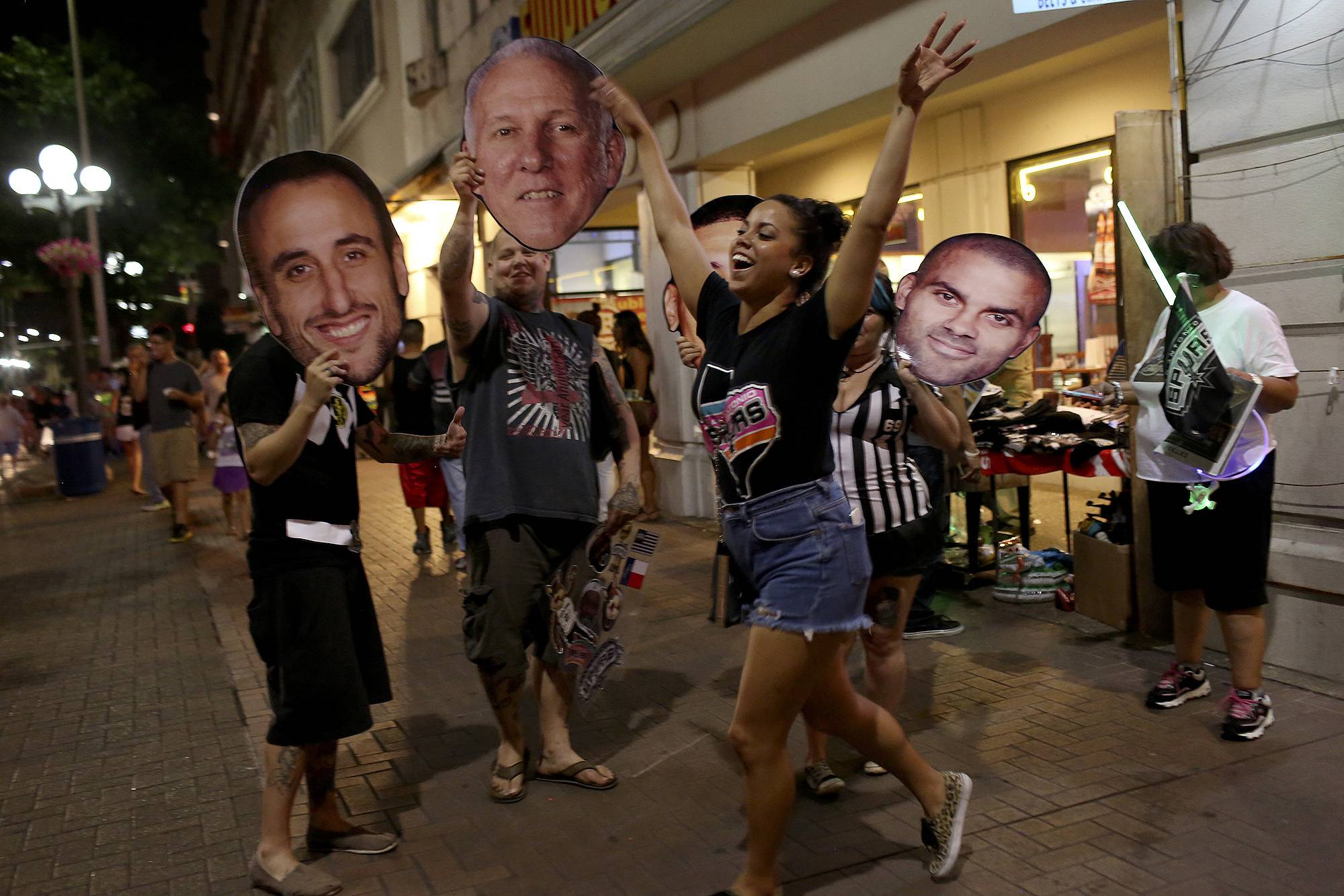 Fans celebrate the Spurs winning the NBA Championship after beating the Miami Heat in downtown San Antonio on Sunday.