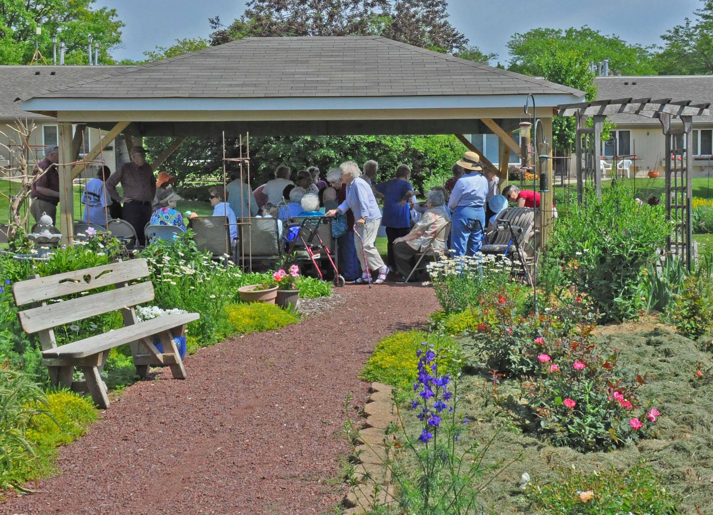 Guests assemble for the dedication of The Holmstad's new pavilion, a destination in the therapeutic garden, which was developed and is maintained by residents of the Batavia retirement community.