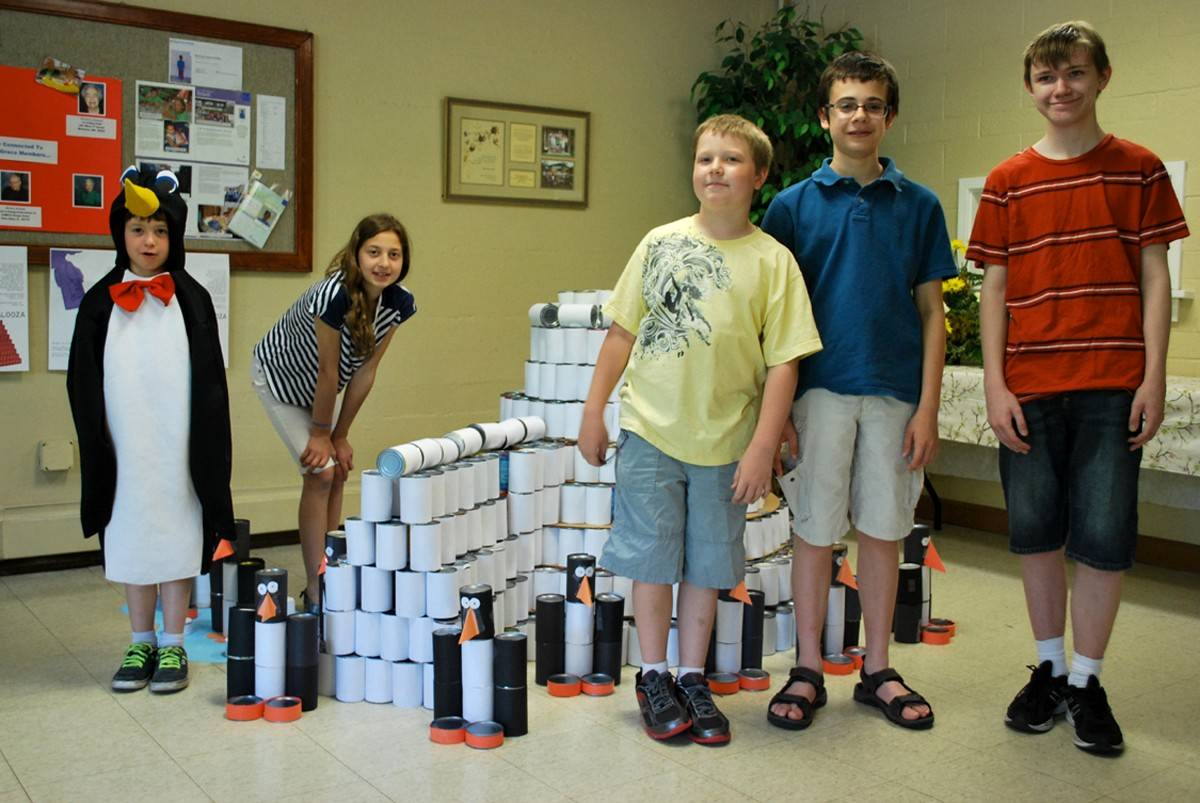 Canapalooza workers, from left, Matthew LoGalbo, Hannah LoGalbo, Nate Nelson, Will Swiston and George Murray compete an igloo sculpture out of some of the 1,120 cans collected for the Glen Ellyn Food Pantry.