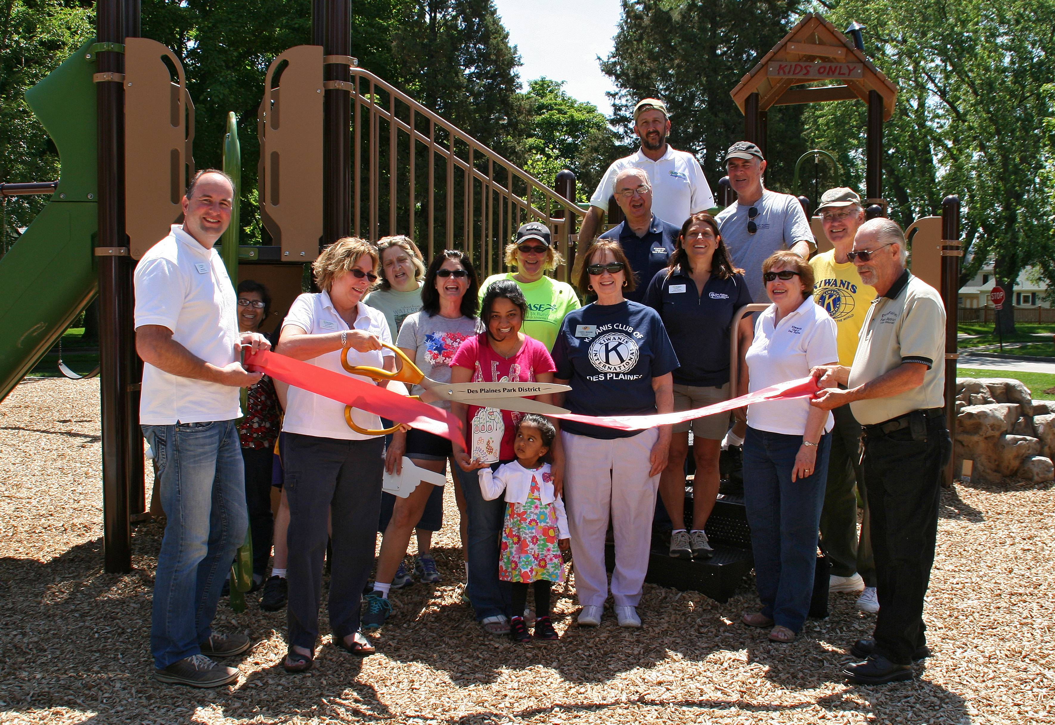 Park Board Commissioner Jana Haas cuts the ribbon at the Grand Opening Ceremony of Kiwanis Park on Saturday, June 14.Lisa Haring
