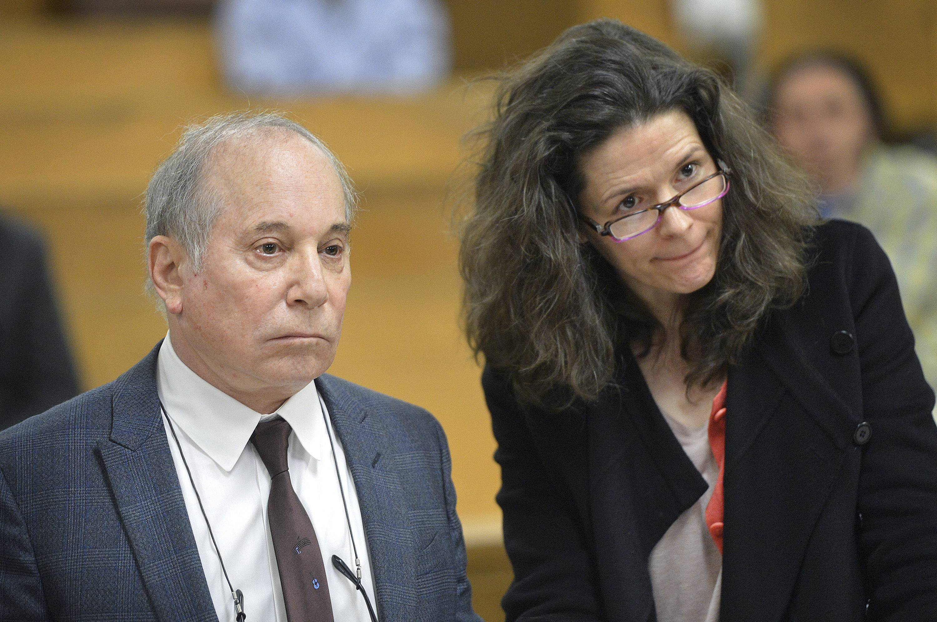 Singer Paul Simon, left, and his wife, Edie Brickell, appear at a hearing in Norwalk Superior Court on April 28 in Norwalk, Conn. The couple were arrested Saturday on disorderly conduct charges by officers investigating a family dispute at their home in New Canaan, Conn.