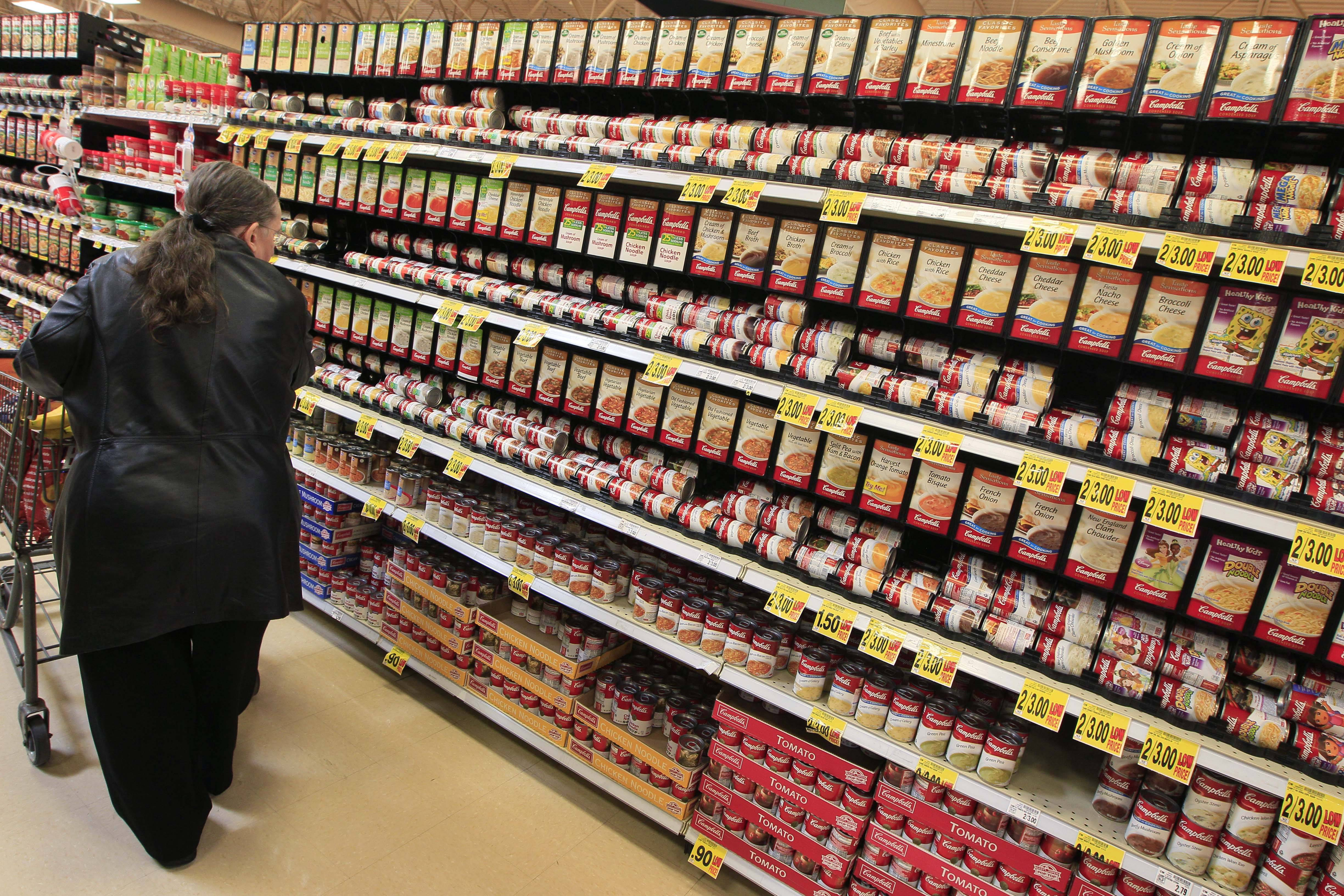 A shopper walking down the canned soup aisle at a grocery store in Cincinnati. Food companies and restaurants could soon face government pressure to make their foods less salty.