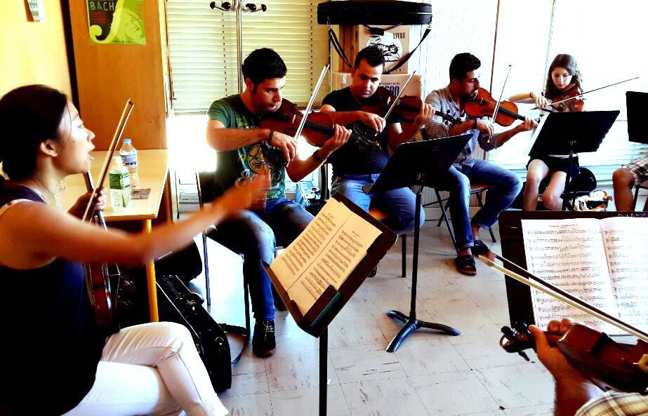 The National Youth Orchestra of Iraq has canceled two August concerts in Elgin, which would have been the beginning of its U.S. debut tour. Here, they rehearse in an undated photo.