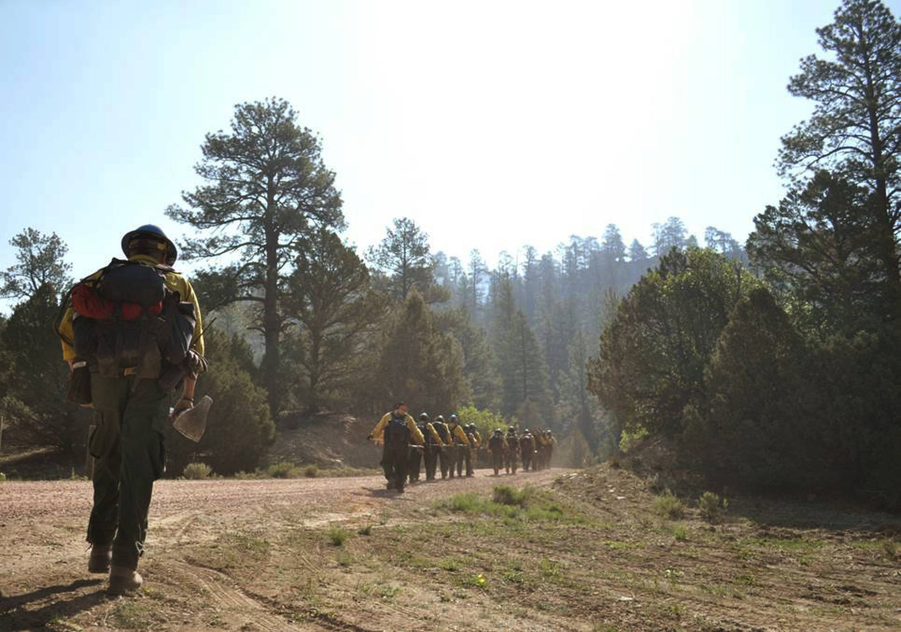 The Navajo Hotshots make their way to the fire in the Chuska Mountains near Asaayi Lake, which is east of Navajo Pine, N.M. Residents of two Native American communities near the New Mexico-Arizona border were forced to leave their homes Monday, June 16, 2014, as strong winds fanned the flames of a wildfire burning in the Chuska Mountains.