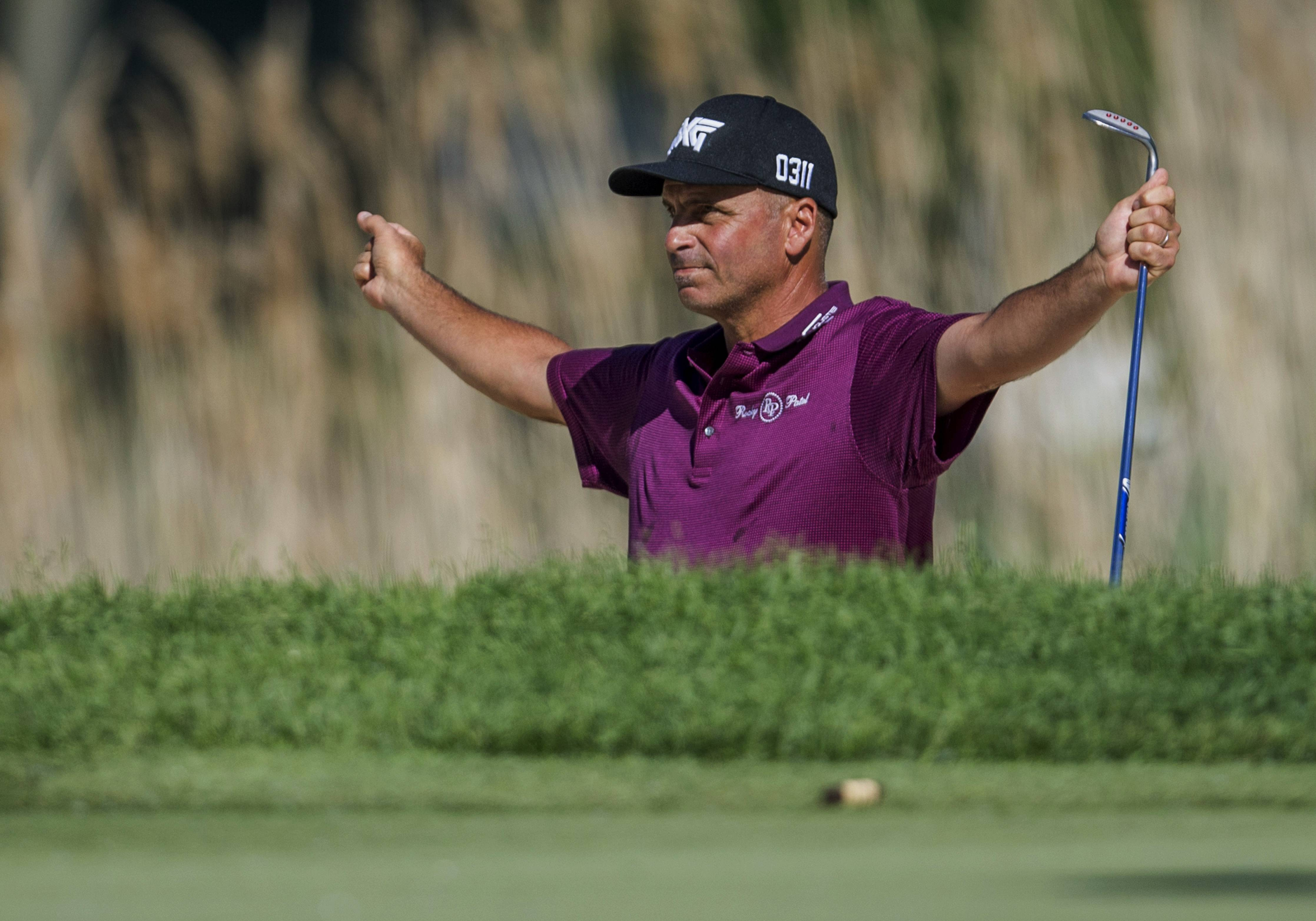 Rocco Mediate celebrates after sinking a shot from the bunker for a birdie on the 17th hole during the final round of the Senior PGA Championship golf tournament at Harbor Shores Golf Club in Benton Harbor, Mich., Sunday, May 29, 2016. Mediate won with a score of 19 under.