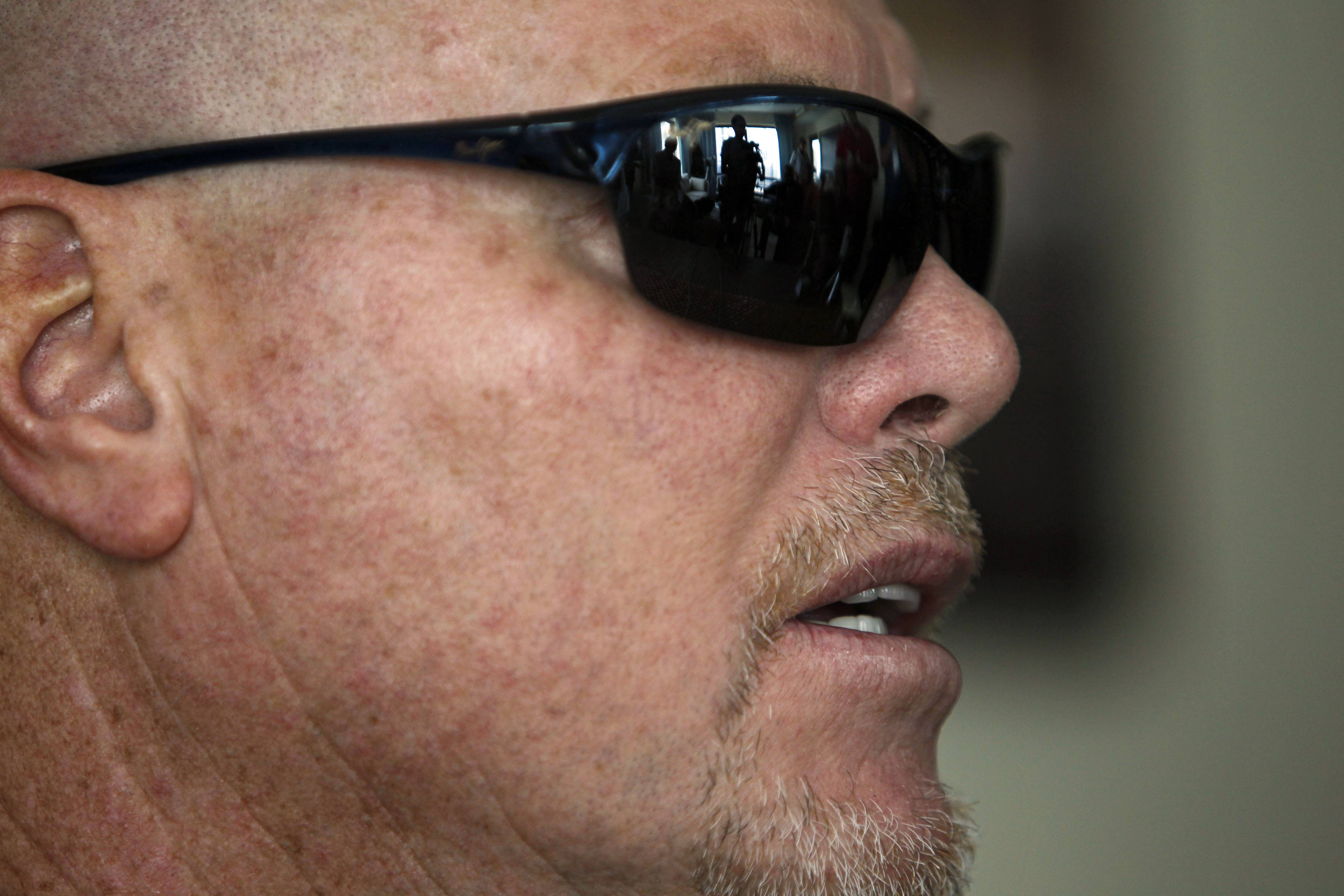 Former NFL football quarterback Jim McMahon speaks during a news conference Tuesday in Chicago. McMahon spoke of his ongoing battle with dementia that he believe is related to his years of hits he took while playing in the league. McMahon is part of a federal lawsuit filed in San Francisco accusing teams of illegally dispensing powerful narcotics and other drugs to keep players on the field without regard for their long-term health. He led the Chicago Bears to victory in the 1985 Super Bowl.